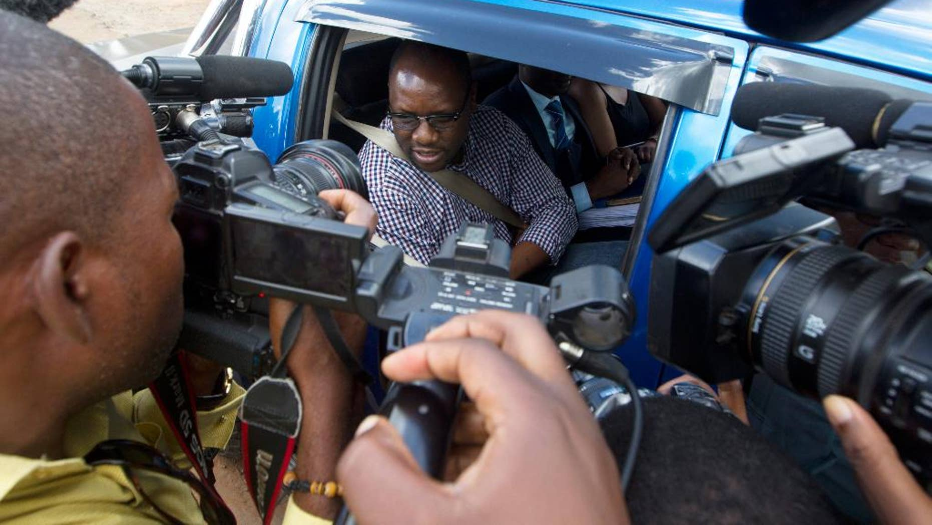 Zimbabwean Pastor Evans Mawarire talks to the media following his release from Chikurubi Maximum Prison on the outskirts of Harare, Thursday, Feb, 9, 2017.  The trail was postponed and Mawarire released on bail, accused of subversion for protests against the government of President Robert Mugabe. (AP Photo/Tsvangirayi Mukwazhi)