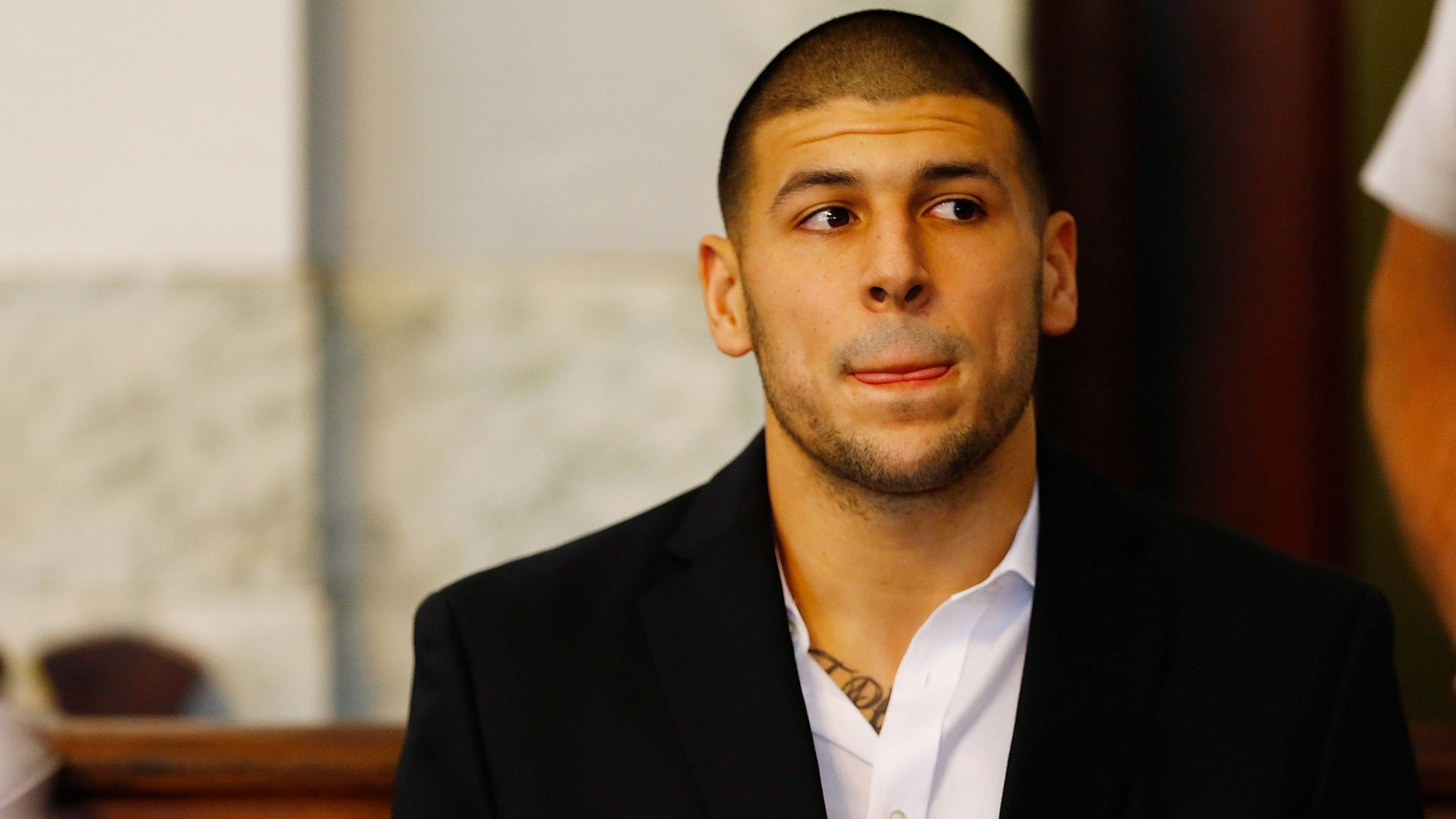 Aaron Hernandez during a hearing on August 22, 2013 in North Attleboro, Massachusetts.