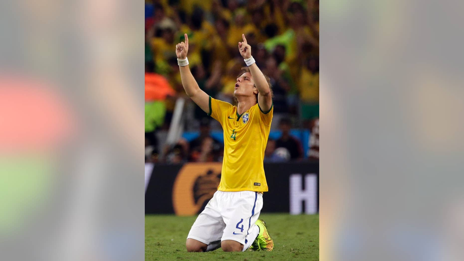 Brazil's David Luiz celebrates at the end of the World Cup quarterfinal soccer match between Brazil and Colombia at the Arena Castelao in Fortaleza, Brazil, Friday, July 4, 2014. Brazil won the match 2-1. (AP Photo/Felipe Dana)