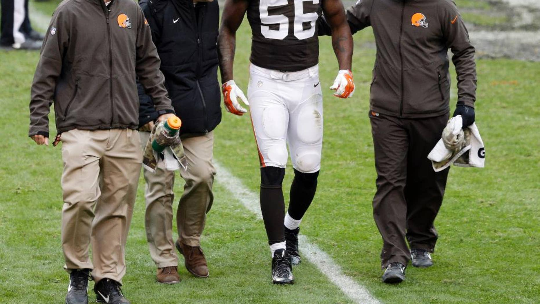 Cleveland Browns inside linebacker Karlos Dansby (56) is helped off the field after an injury in the second quarter of an NFL football game against the Houston Texans, Sunday, Nov. 16, 2014, in Cleveland. (AP Photo/Tony Dejak)