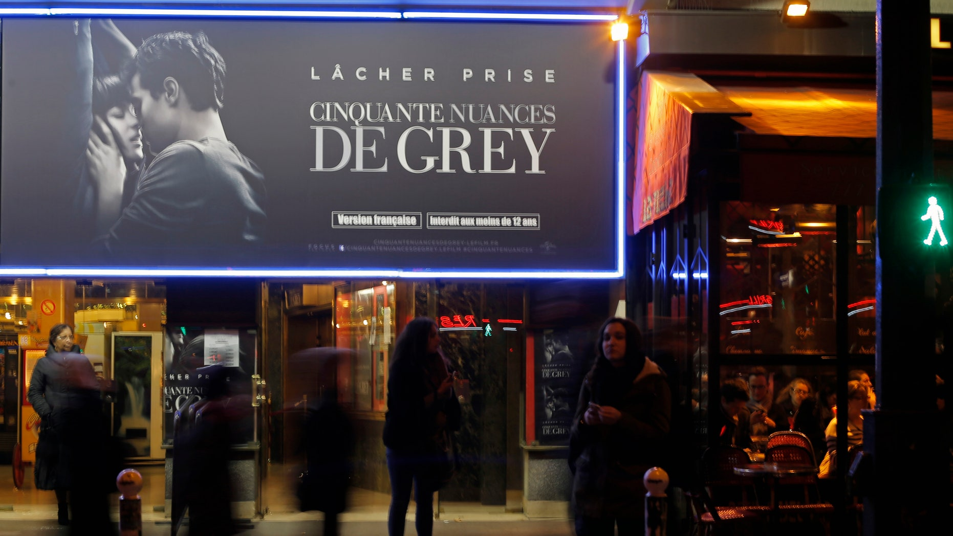 "Parisians gather in front of a cinema playing ""Fifty Shades of Grey"" directed by Sam Taylor-Johnson, inspired by the 2011 erotic romance novel by British author E. L. James,  in Paris, France, Wednesday, Feb. 11, 2015. Children as young as 12 are heading to see the highly-anticipated erotic drama âFifty Shades of Greyâ in France on its release Wednesday, after the countryâs film board decided against giving it an adult certificate. (AP Photo/Francois Mori)"