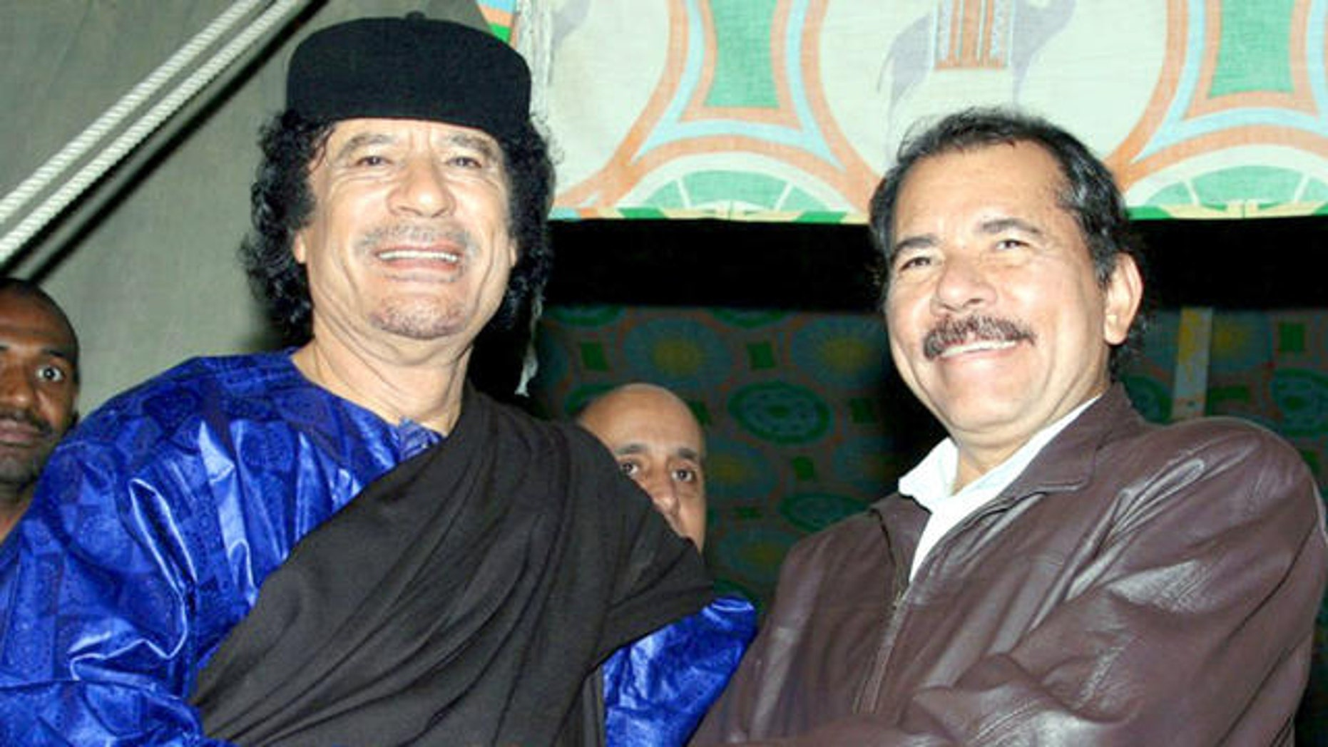In this handout photo released by Presidential House of Nicaragua,  Libyan leader Moammar Gadhafi, left, shakes hands with Nicaragua's President Daniel Ortega during a meeting in Tripoli, Libya, Tuesday, June 5, 2007.(AP Photo/Presidential House of Nicaragua/Jairo Cajina) ** NO SALES **