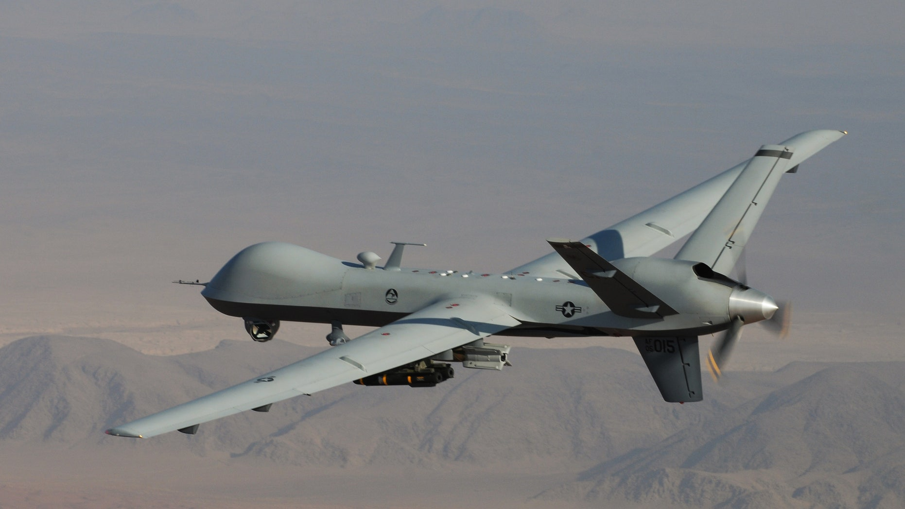 In this undated handout file photo provided by the U.S. Air Force, an MQ-9 Reaper, armed with GBU-12 Paveway II laser guided munitions and AGM-114 Hellfire missiles, is piloted by Col. Lex Turner during a combat mission over southern Afghanistan.