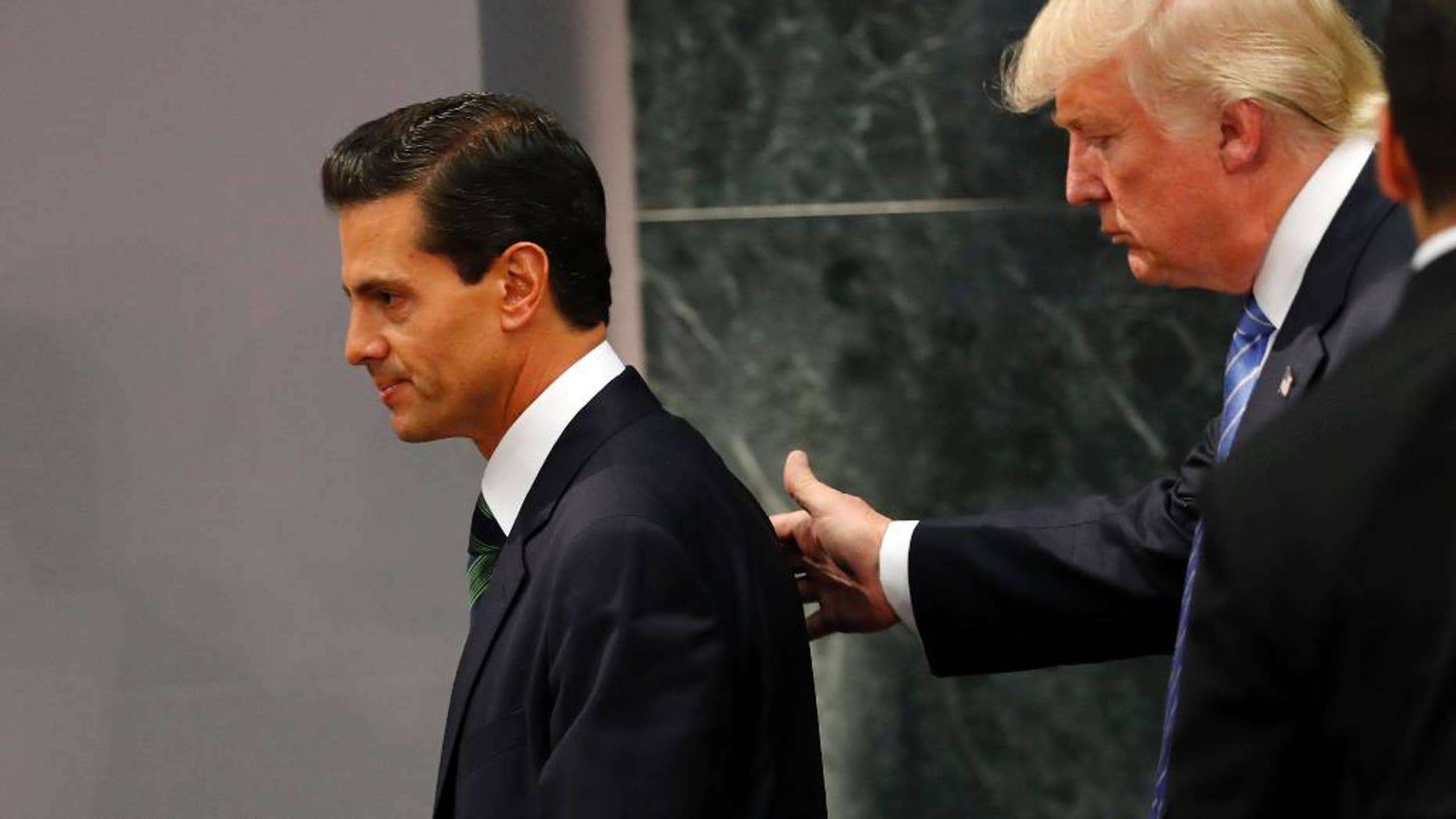 FILE - In this Aug. 31, 2016, file photo, Republican presidential nominee Donald Trump walks with Mexico's President Enrique Pena Nieto at the end of their joint statement at Los Pinos, the presidential official residence, in Mexico City. President Pena Nieto said Sunday, Oct. 23, that he could have done a better job handling the controversial meeting with the Republican candidate. (AP Photo/Dario Lopez-Mills, File)