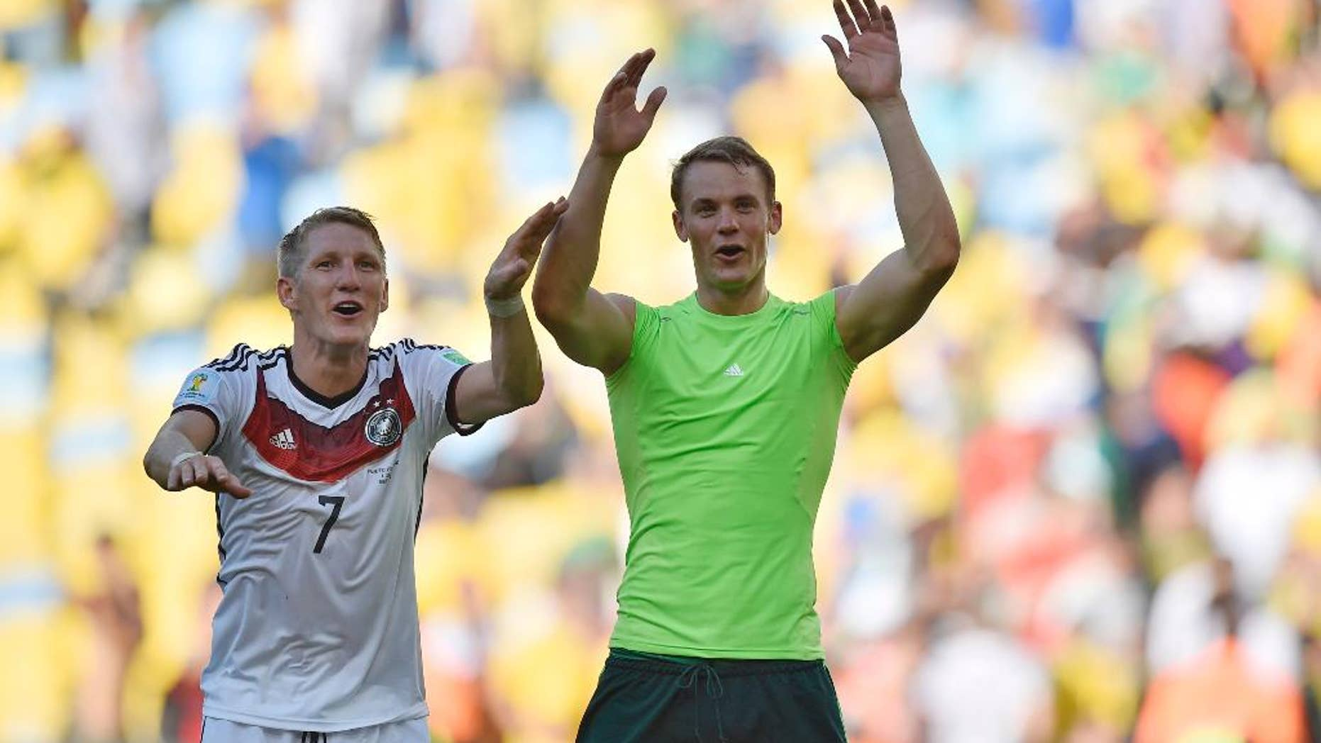 Germany's Bastian Schweinsteiger, left, and goalkeeper Manuel Neuer celebrate at the end of  the World Cup quarterfinal soccer match between Germany and France at the Maracana Stadium in Rio de Janeiro, Brazil, Friday, July 4, 2014. Germany won the match 1-0.   (AP Photo/Martin Meissner)