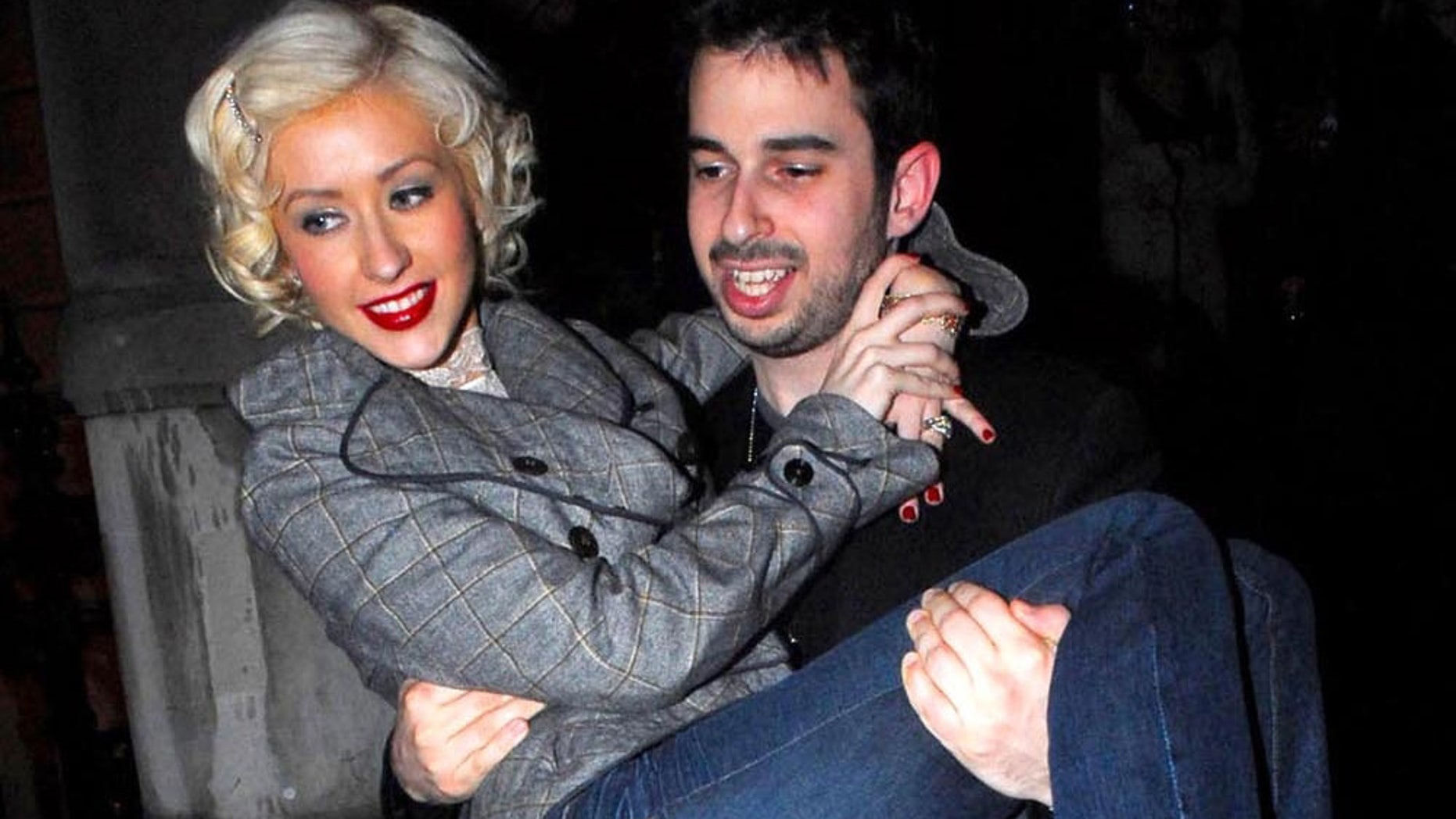 Photo © 2006 The Grosby Group -London, Mar 07 2006Pop super star Christina Aguilera, who is currently in London recording her new album, leaves her exclusive London hotel with hubby Jordan Bratman , and they head off to the meet headquakers in knightsbridge.Christina emerge looking sightly unsteady on her feet!The couple then wentÊonto celeb nightspot boujis, were they partying until the early hours. Jordan had to carry Christina back to the hotel as they go out of the car and she gave him a big kiss to thank him for it, smudging her bright red lipstick over her face!(PR)