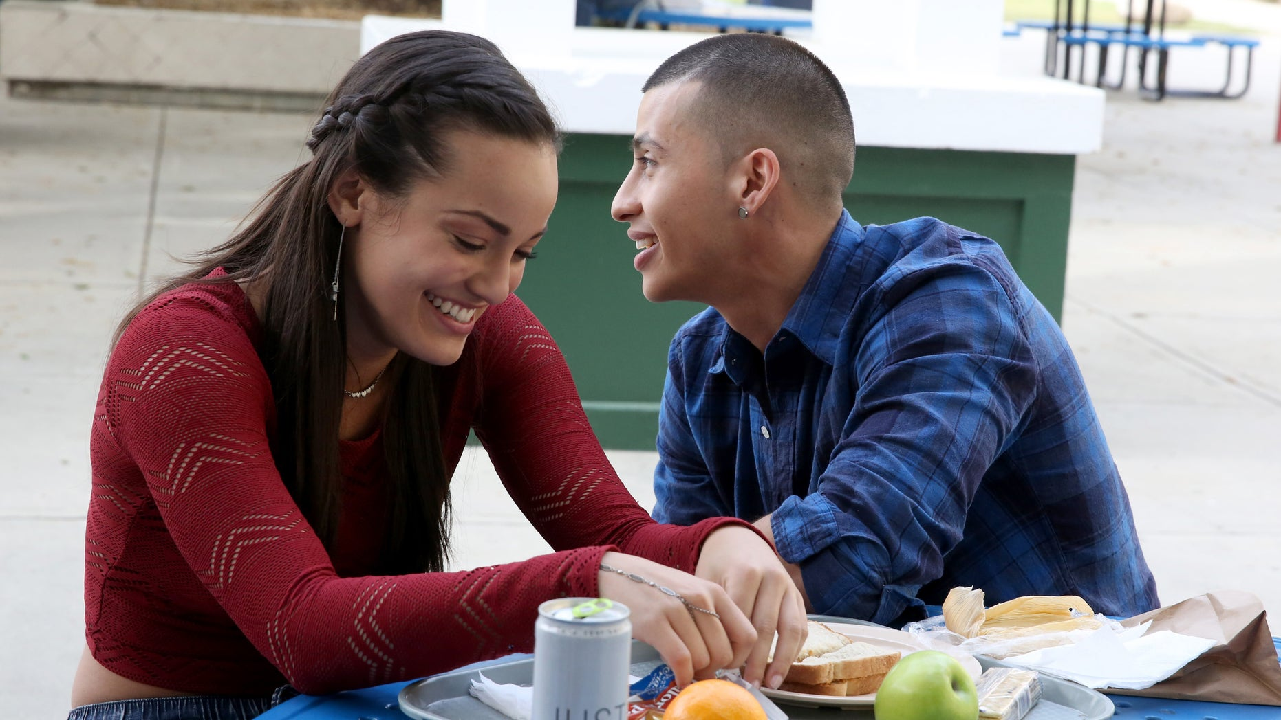Alexandra Rodriguez and Carlito Olivero on the set of East Los High 3.