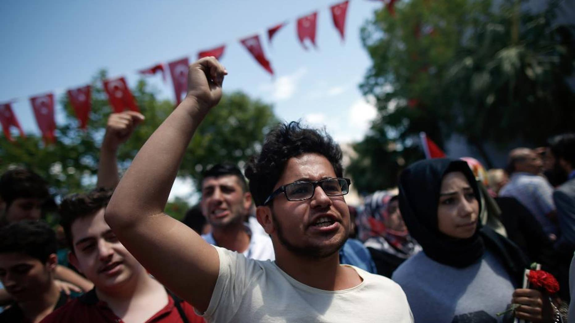 June 8, 2016: People shout to condemn terrorism as they visit the site of Tuesday explosion in Istanbul.