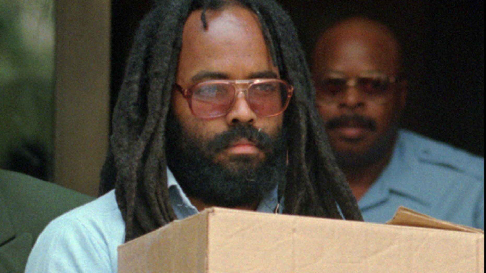 Mumia Abu-Jamal leaves Philadelphia's City Hall after a hearing in 1995. (AP)