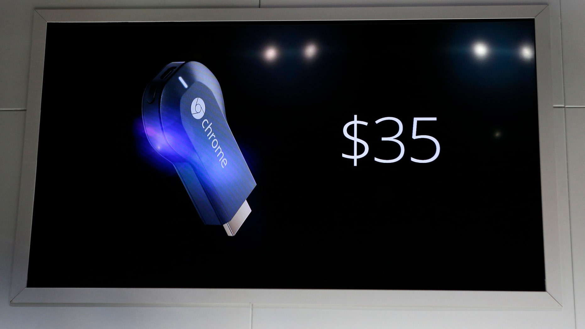 File photo: The new Google Chromecast dongle is pictured on an electronic screen as it is announced during a Google event at Dogpatch Studio in San Francisco, California, July 24, 2013. (REUTERS/Beck Diefenbach)