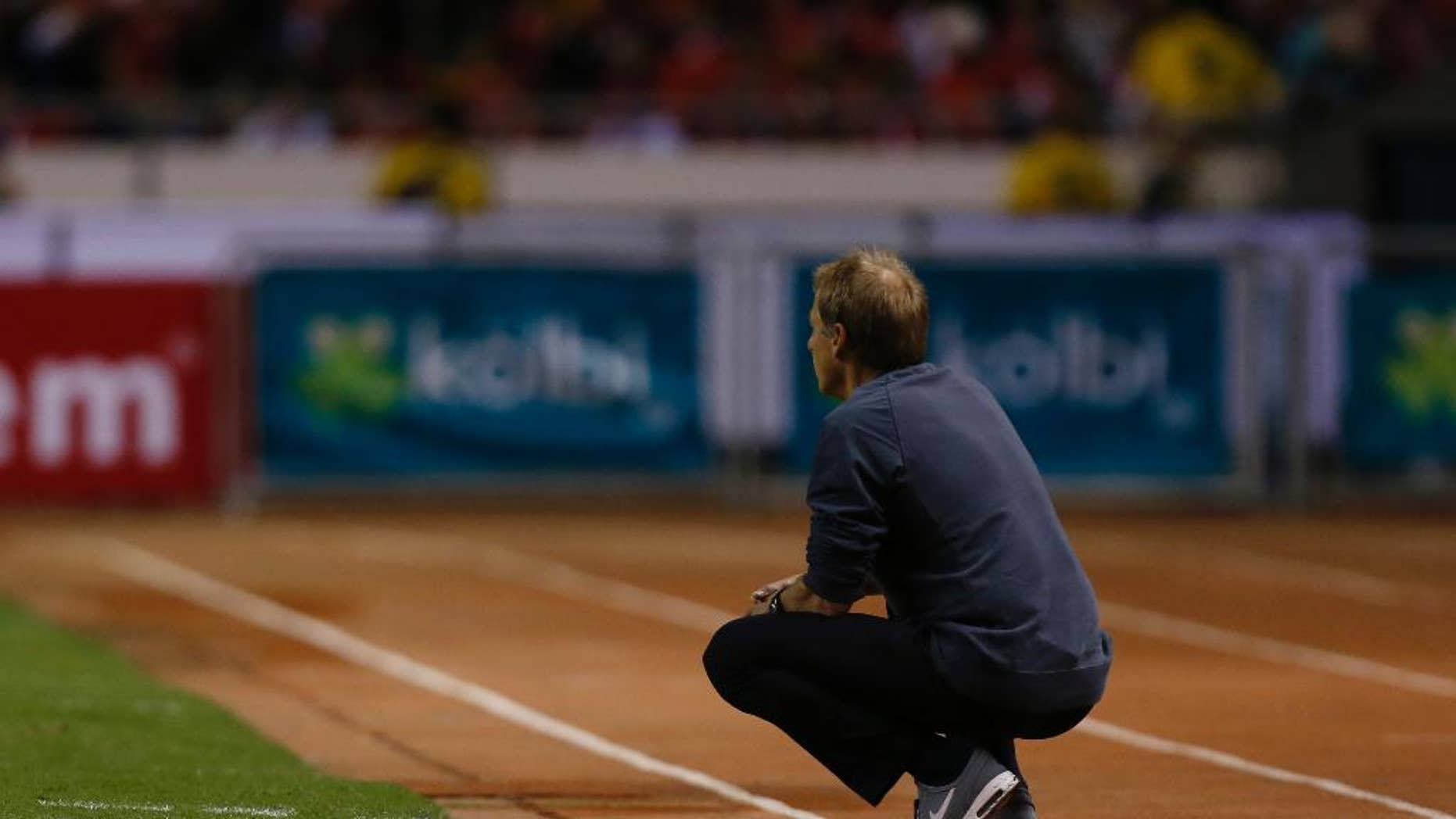 United States coach Jurgen Klinsmann watches the game on the sideline during a 2018 World Cup qualifying soccer match against Costa Rica, in San Jose, Costa Rica, Tuesday, Nov. 15, 2016. United States lost 4-0 to Costa Rica. (AP Photo/Moises Castillo)