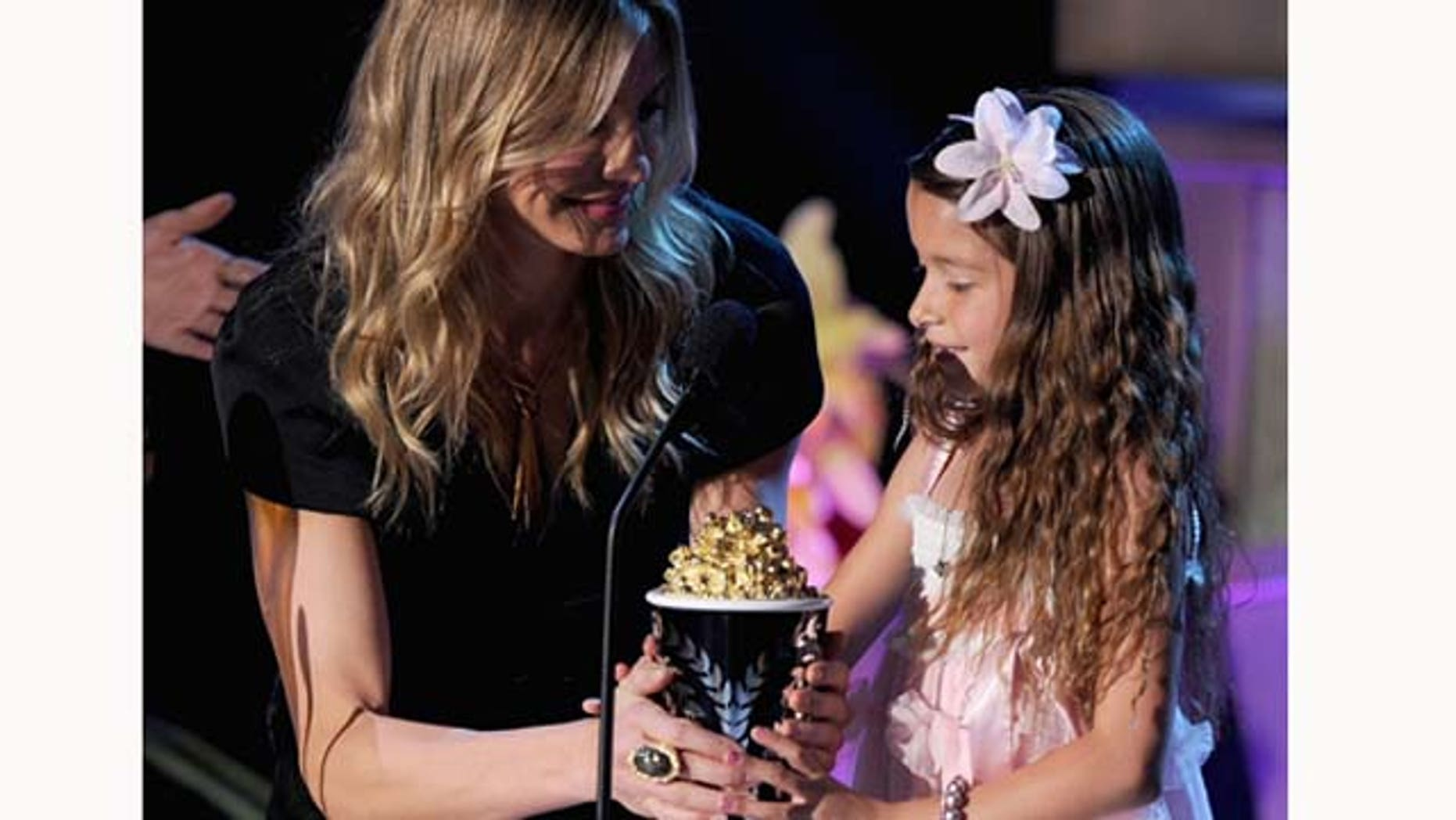 June 5, 2011: Actress Cameron Díaz presents the Best Line From A Movie award to actress Alexys Nycole Sánchez onstage during the 2011 MTV Movie Awards at Universal Studios' Gibson Amphitheatre on June 5, 2011 in Universal City, Calif.
