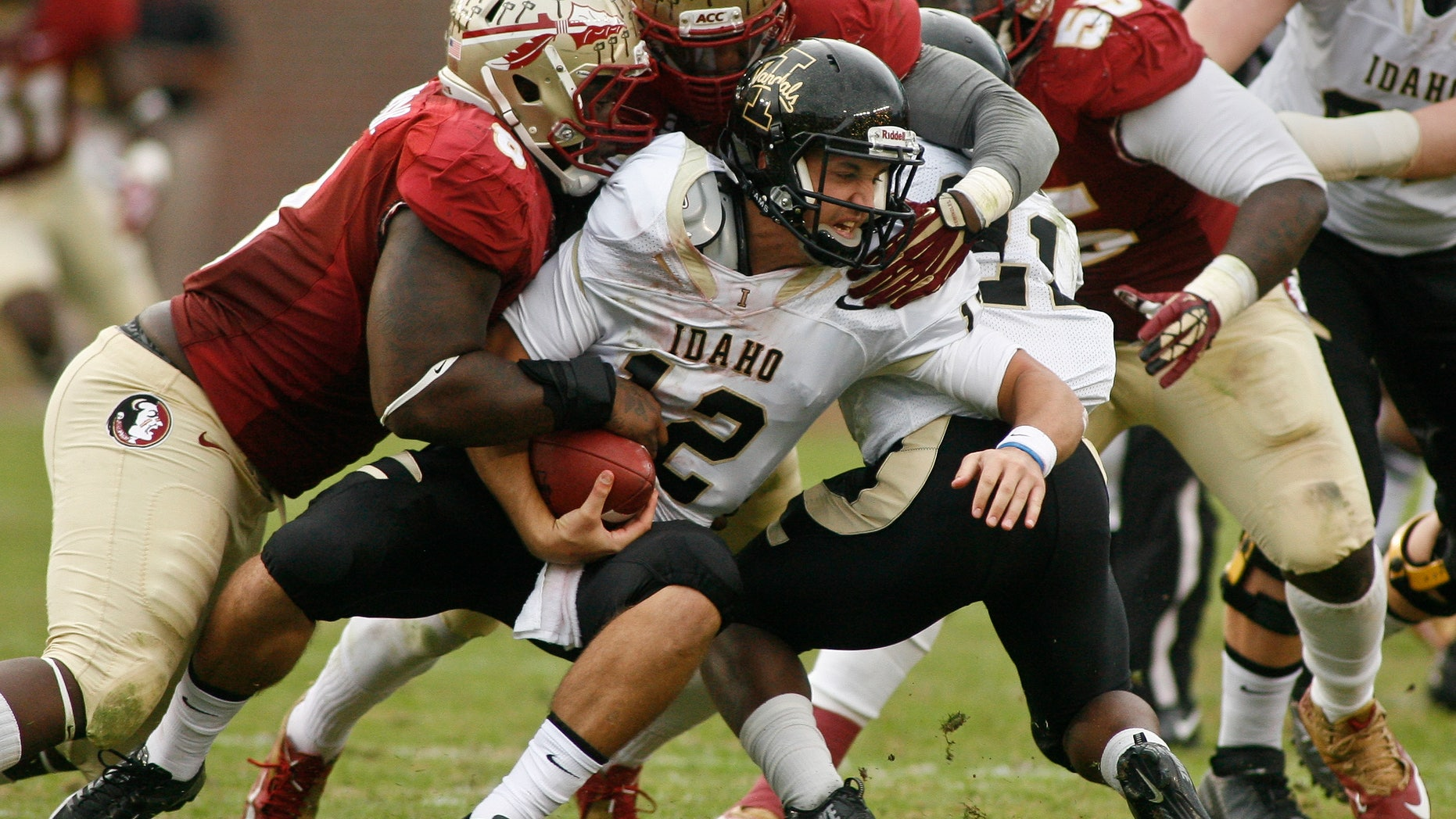 Florida State defensive tackle Timmy Jernigan (8), linebacker Christian Jones (7) and defensive tackle Jacobbi McDaniel (55) combine to sack Idaho quarterback Taylor Davis (12) in the first half of an NCAA college football game on Saturday, Nov. 23, 2013 in Tallahassee, Fla. (AP Photo/Phil Sears)