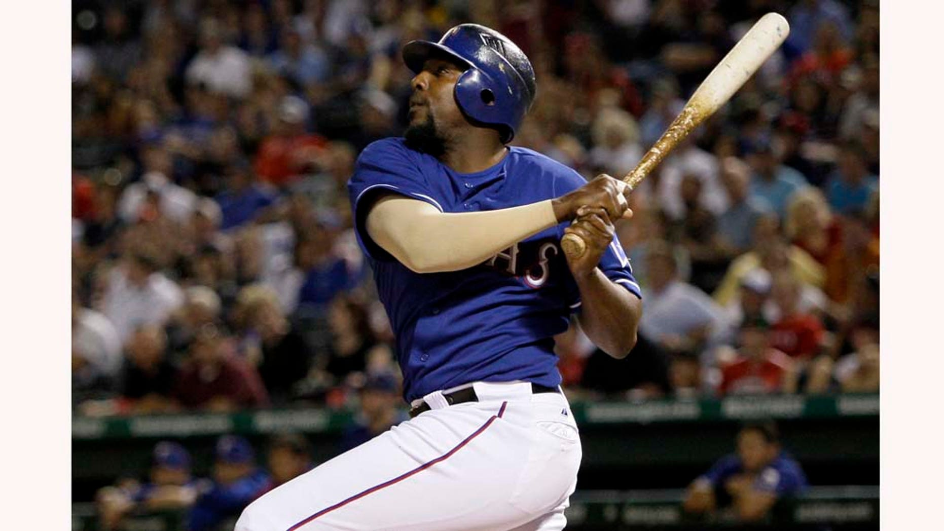 FILE - In this May 6, 2010, file photo, Texas Rangers' Vladimir Guerrero looks on after hitting a two-run home run off Kansas City Royals' Josh Rupe in the sixth inning of a baseball game in Arlington, Texas. A person with knowledge of the situation says free agent slugger Guerrero has agreed to one-year contract with the Baltimore Orioles. The person spoke Friday, Feb. 4, 2011, to The Associated Press on the condition of anonymity because the deal will not be completed until Guerrero passes a physical. (AP Photo/Tony Gutierrez, File)