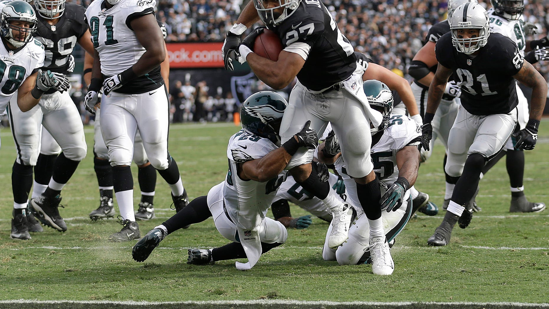 Oakland Raiders running back Rashad Jennings (27) runs for an 8-yard touchdown against the Philadelphia Eagles during the second quarter of an NFL football game in Oakland, Calif., Sunday, Nov. 3, 2013. (AP Photo/Marcio Jose Sanchez)