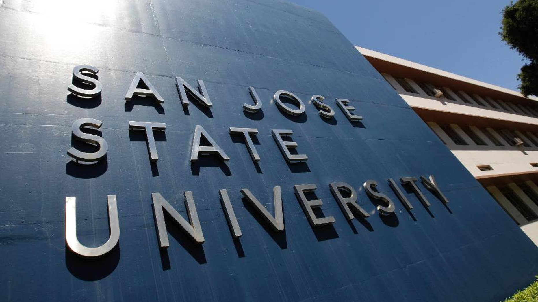 File - In this June 30, 2011 file photo is an exterior view of San Jose State University in San Jose, Calif. When a water polo player at San Jose State was accused of sexually assaulting two women over Labor Day weekend, the university acted decisively. The athlete was moved from his freshman dorm into a staff housing facility, temporarily suspended and barred from campus. (AP Photo/Paul Sakuma, File)