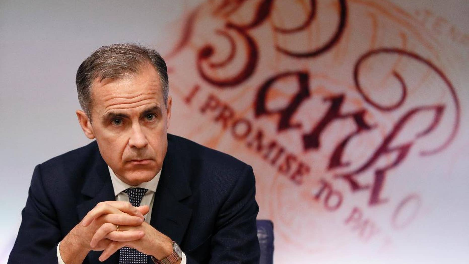 FILE - In this Thursday, Feb. 2, 2017 file photo, Mark Carney, Governor of the Bank of England listens during a quarterly Inflation Report press conference at the bank in London. The Bank of England has kept its key interest rate at a record-low 0.25 percent to avoid slowing economic growth as Britain prepares to leave the European Union. The bank's Monetary Policy Committee voted Thursday, March 16 to keep its key rate on hold for an eighth straight month, a day after the U.S. Federal Reserve raised its benchmark rate. (AP Photo/Kirsty Wigglesworth, file)
