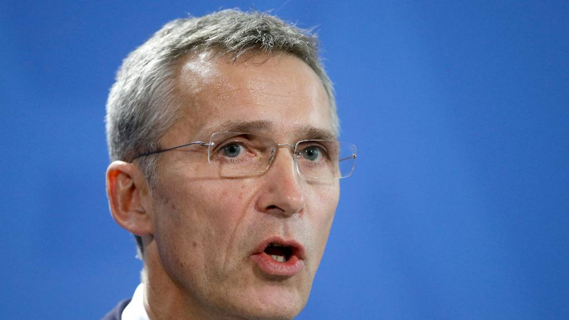 NATO Secretary General Jens Stoltenberg speaks during a joint press conference as part of a meeting with German Chancellor Angela Merkel at the chancellery in Berlin, Germany, Wednesday, Jan. 14, 2015. (AP Photo/Michael Sohn)