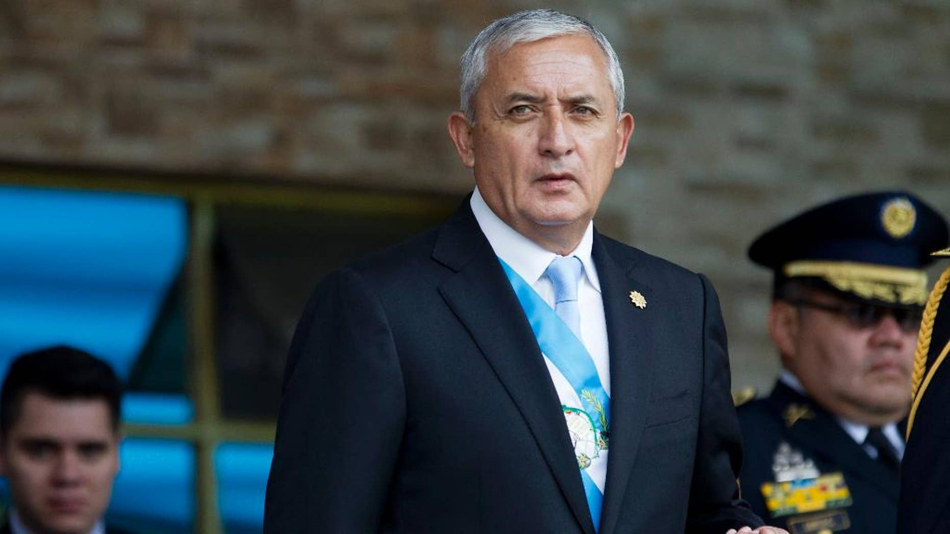 FILE - In this June 30, 2015, file photo, Guatemala's President Otto Perez Molina arrives to the Army general headquarters for the Army Day parade in Guatemala City. An attempt to withdraw Perez Molina's immunity from prosecution died in Congress on Thursday, Aug. 13, 2015, following a string of corruption scandals that sparked large protests. (AP Photo/Moises Castillo, File)
