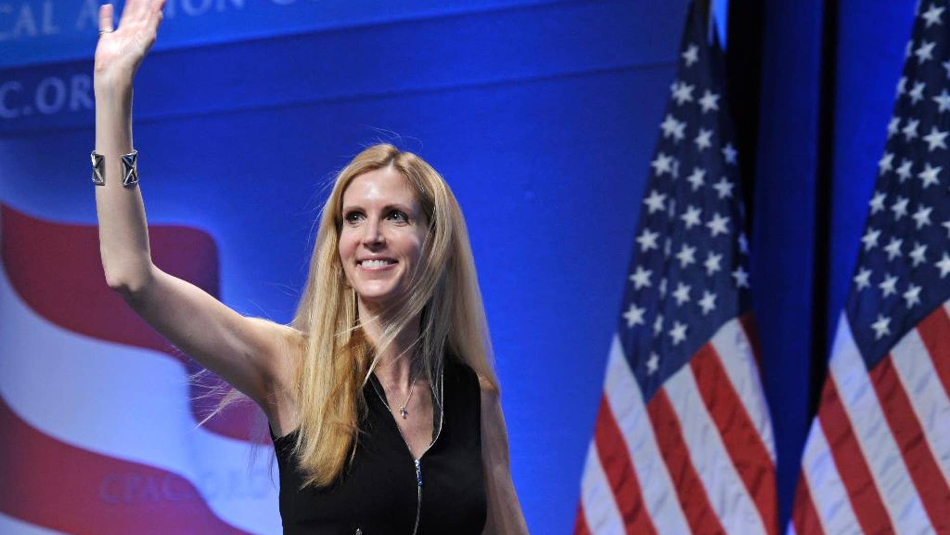"""FILE - In this Feb. 12, 2011 file photo, Ann Coulter waves to the audience after speaking at the Conservative Political Action Conference (CPAC) in Washington. Coulter's planned appearance at the University of California, Berkeley on April 27 has been canceled because of security concerns. UC Berkeley officials say they were unable to find """"a safe and suitable"""" venue for the right-wing provocateur, whom campus Republicans had invited to speak. (AP Photo/Cliff Owen, File)"""