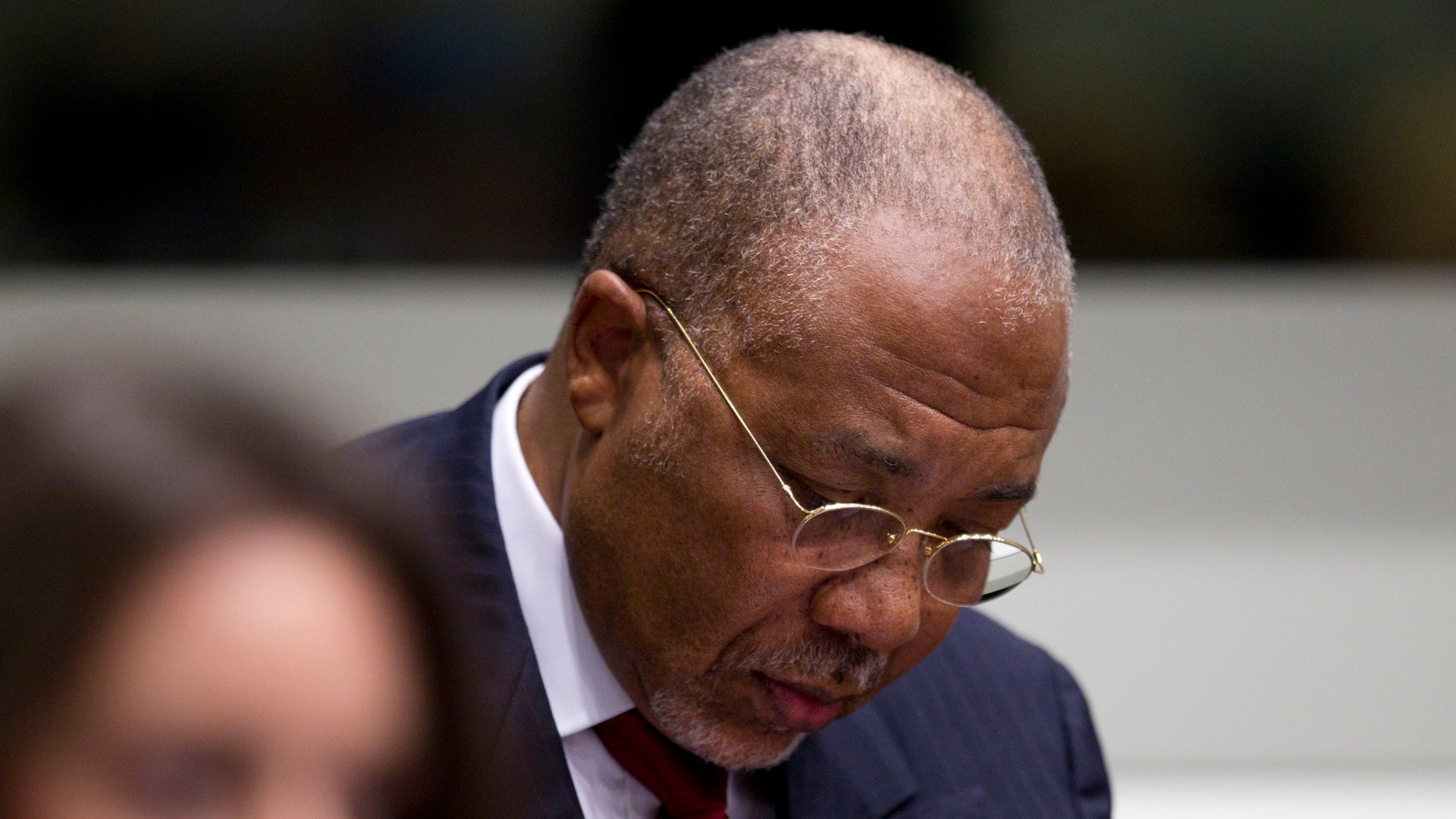 April 26: Former Liberian President Charles Taylor looks down as he waits for the start of a hearing to deliver verdict in the court room of the Special Court for Sierra Leone in Leidschendam, near The Hague, Netherlands.