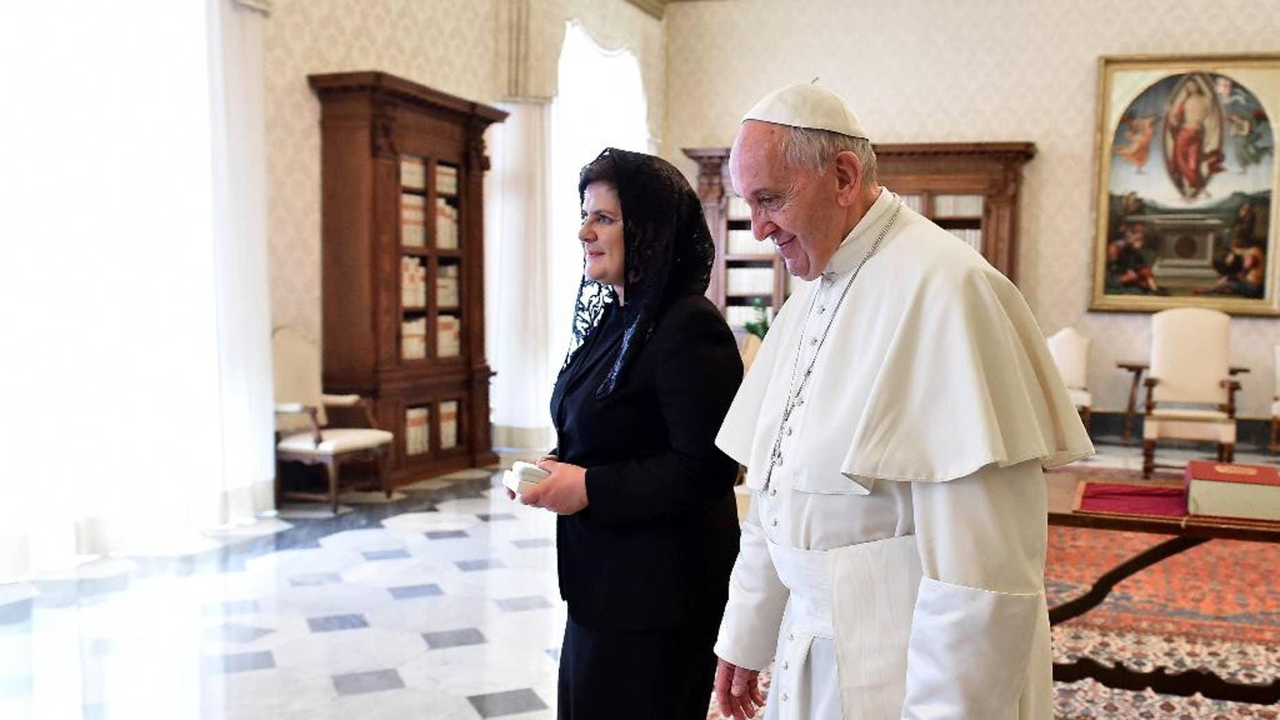 Pope Francis talks with Poland's Prime Minister Beata Szydlo during a private audience in the pontiff's studio at the Vatican, Friday, May 13, 2016. (Gabriel Bouys/AFP Pool via AP)