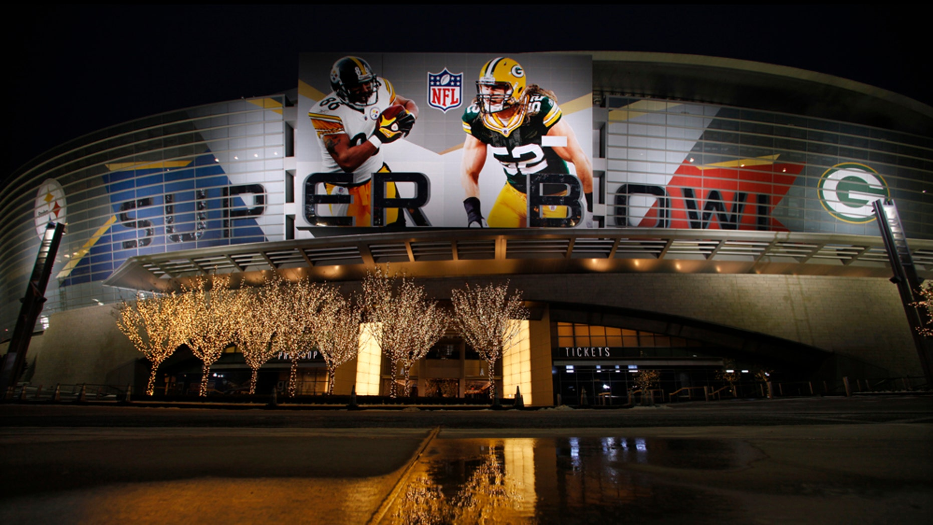 Lights are reflected on an icy pavement outside of Cowboys Stadium where the NFL football Super Bowl XLV will be played between the Green Bay Packers and the Pittsburgh Steelers Thursday, Feb. 3, 2011, in Arlington, Texas. (AP Photo/Charlie Riedel)