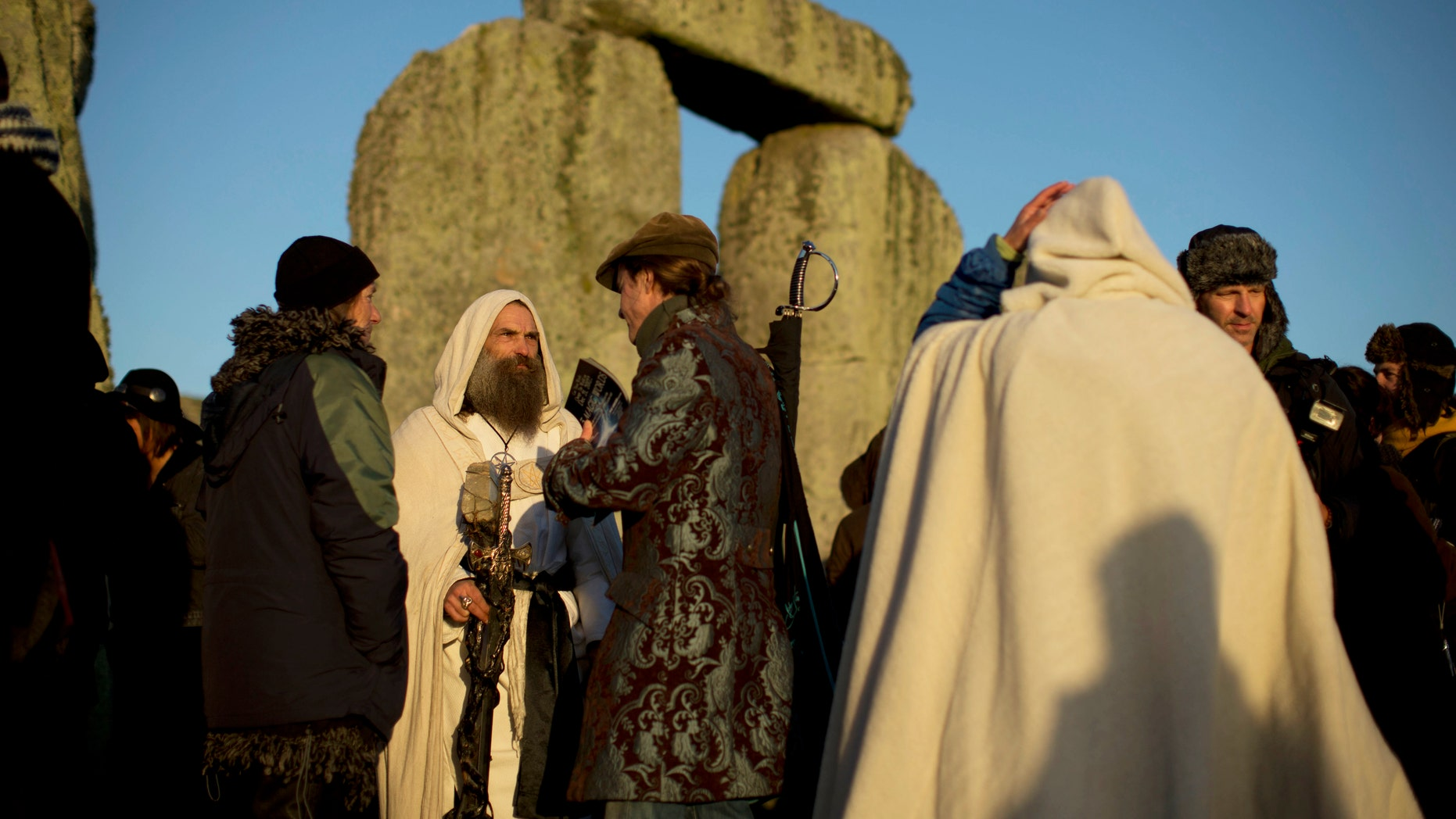 December 21, 2012: A Druid stands after sunrise at the old stone circle of Stonehenge.