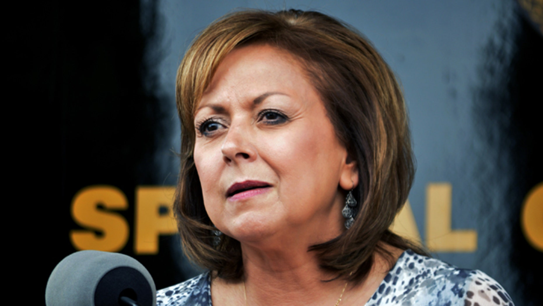 """FILE - This Sept. 4, 2015 file photo New Mexico Gov. Susana Martinez speaks at a press conference Albuquerque, N.M. Martinez says she's confident a close political adviser, Jay McCleskey, did nothing wrong and called allegations of fundraising violations """"cheap shots."""" The Republican governor told The Associated Press in a statement that she's aware of complaints being raised and said they came from political opponents who have tried to attack her previously. (AP Photo/Russell Contreras,File)"""