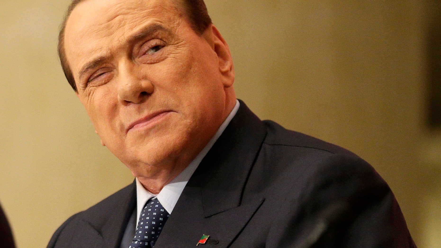 """In this Dec. 4, 2013 photo former Premier Silvio Berlusconi attends the launch of a book """"Sale, zucchero e caffe'"""" (Salt, Sugar and Coffee) by his friend, journalist Bruno Vespa, in Rome. Berlusconi's political corruption trial has opened in the southern city of Naples on Tuesday, Feb. 11, 2014, yet another legal challenge for the three-time former premier. Berlusconi is accused of paying a senator 3 million euros (4 million US dollars) to a bolt a rival government, which eventually fell. (AP Photo/Alessandra Tarantino)"""