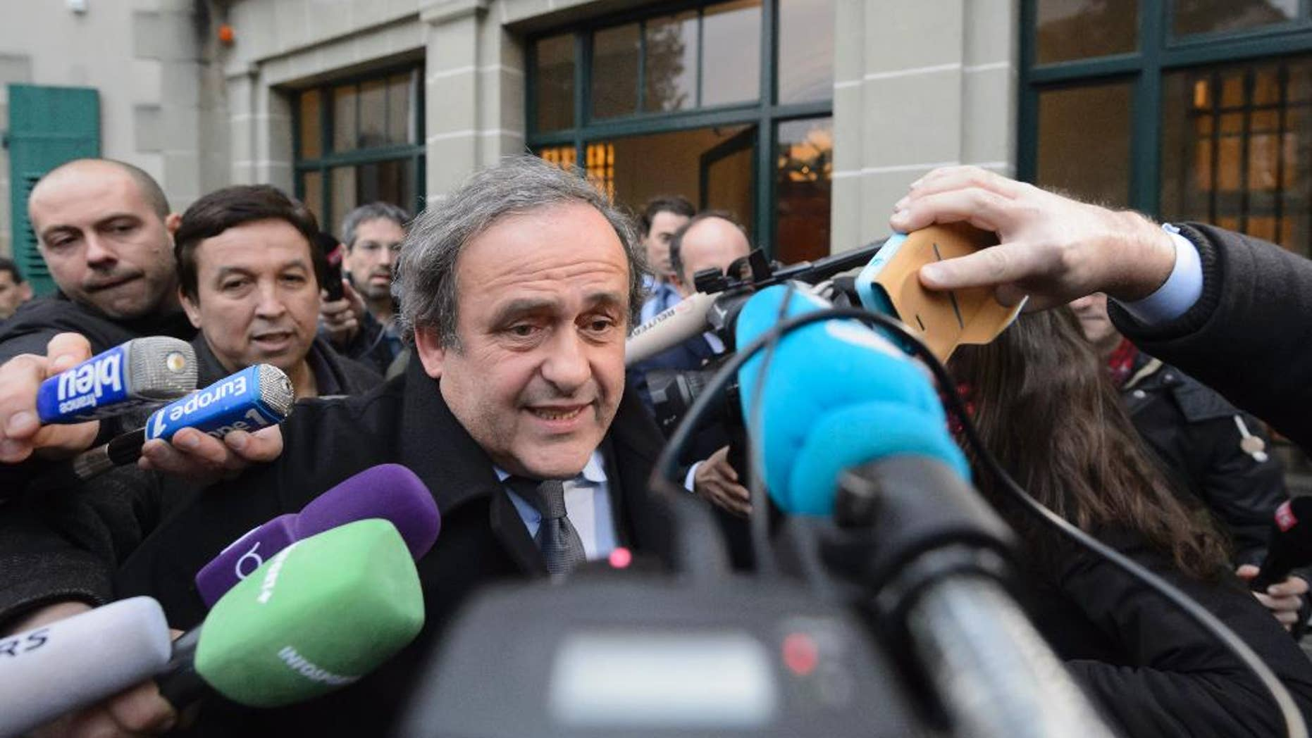 UEFA-President Michel Platini of France is surrounded by media after a hearing at the international Court of Arbitration for Sport, CAS, in Lausanne, Switzerland, Tuesday, Dec. 8, 2015. Platini appealed against a 90-day ban which is keeping him out of the presidential race for the sport's scandal-plagued governing body FIFA. (Laurent Gillieron/Keystone via AP)