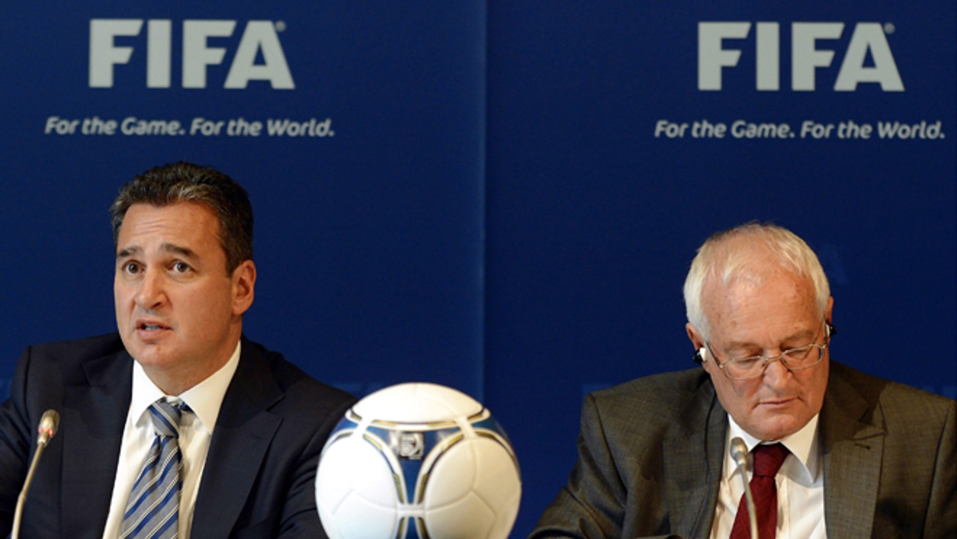 FILE - In this Friday, July 27, 2012 file photo, Chairmen of the two chambers of the new FIFA Ethics Committee Michael Garcia, left, from the US and Joachim Eckert, right, from Germany attend a press conference, at the Home of FIFA in Zurich, Switzerland. FIFA ethics judge Joachim Eckert is unlikely to reach final decisions in the 2018 and 2022 World Cup bidding corruption probe until early next year.  FIFA has cleared Russia and Qatar of any wrongdoing in their winning bids for the next two World Cups. German judge Joachim Eckert formally closed FIFAs probe into the 2018 and 2022 World Cup bidding contests on Thursday, almost four years after the vote by the governing body's scandal-tainted executive committee. Eckert noted wrongdoing among the 11 bidding nations in a 42-page summary of FIFA prosecutor Michael Garcias investigations. (AP Photo/Keystone, Walter Bieri, File)