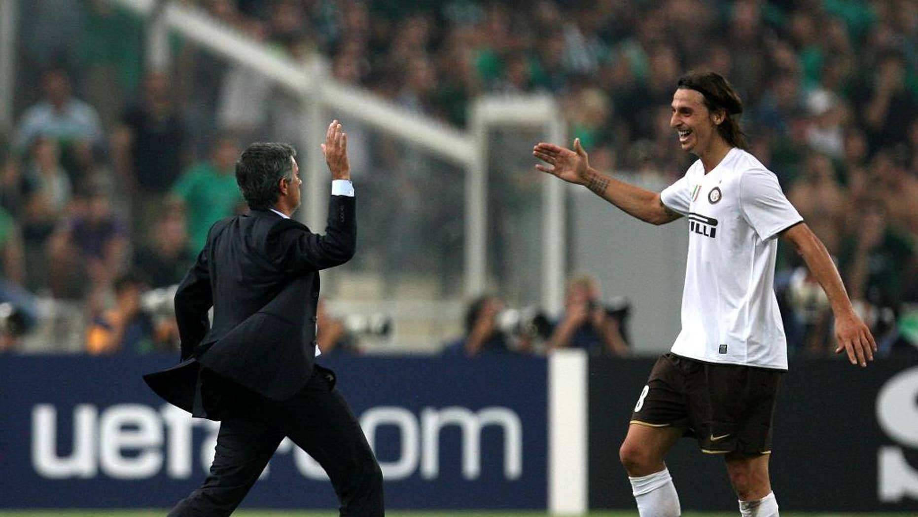 FILE - In this Tuesday, Sept. 16, 2008 file photo, Inter Milan coach Jose Mourinho congratulates Zlatan Ibrahimovic, right, after scoring against Panathinaikos, during a Champions League soccer match at the Olympic stadium of Athens. Zlatan Ibrahimovic said on his official social media accounts Wednesday, June 30, 2016 that his next club will be Manchester United. (AP Photo/Thanassis Stavrakis, File)