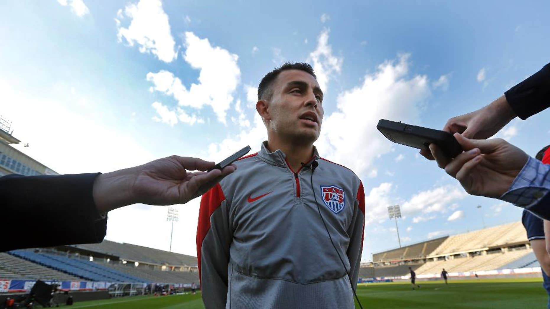 United States forward Miguel Ibarra speaks to reporters prior to training at Rentschler Field in East Hartford, Conn., Thursday, Oct. 9, 2014. The U.S. will host Ecuador in a friendly soccer match on Friday. (AP Photo/Elise Amendola)