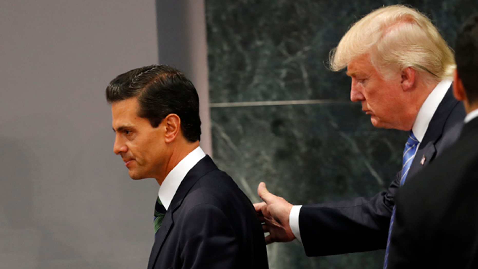 Republican presidential nominee Donald Trump walks with Mexico President Enrique Pena Nieto at the end of their joint statement at Los Pinos, the presidential official residence, in Mexico City, Wednesday, Aug. 31, 2016. Trump is calling his surprise visit to Mexico City Wednesday a 'great honor.'  The Republican presidential nominee said after meeting with Peña Nieto that the pair had a substantive, direct and constructive exchange of ideas.(AP Photo/Dario Lopez-Mills)