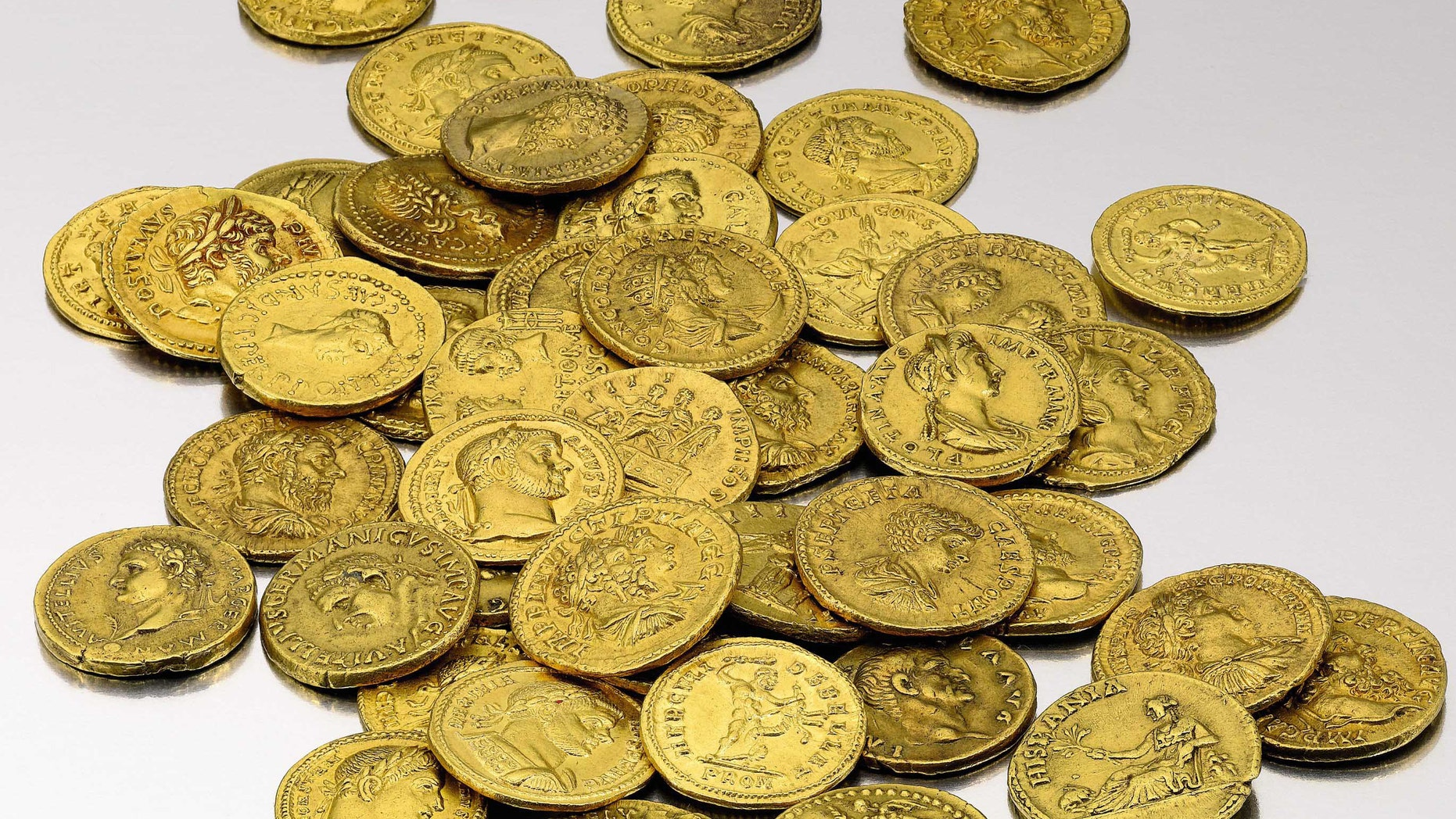 This undated photo provided by Sotheby's showssome gold coins from the 37,895 piece Archer M. Huntington Collection, that will be auctioned by Sotheby's in New York.  The collection Spanish coins dating back to the ancient world  is expected to realize between $25/35 million, and will be on public exhibition in its entirety  during February 2012. (AP Photo/Sotheby's)