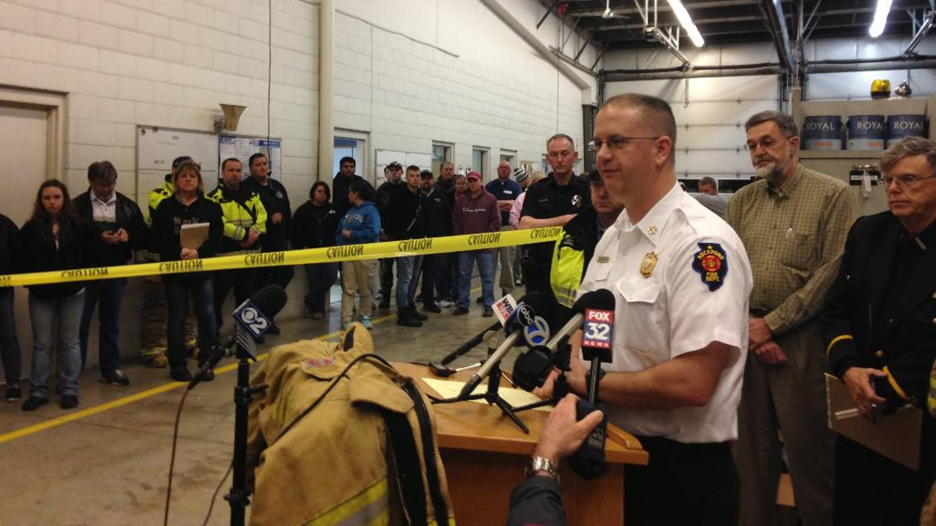Rockford Fire Department Division Chief Matthew Knott speaks Friday April 10, 2015 at a news conference in Kirkland Illinois about the tornado that hit the small community of Fairdale Illinois on Thursday. Knott  said one person, a 67-year-old woman, died and seven people were injured. The tornado impacted all of the roughly 50 homes in Fairdale, destroying many of them. (AP Photo/Sara Burnett)