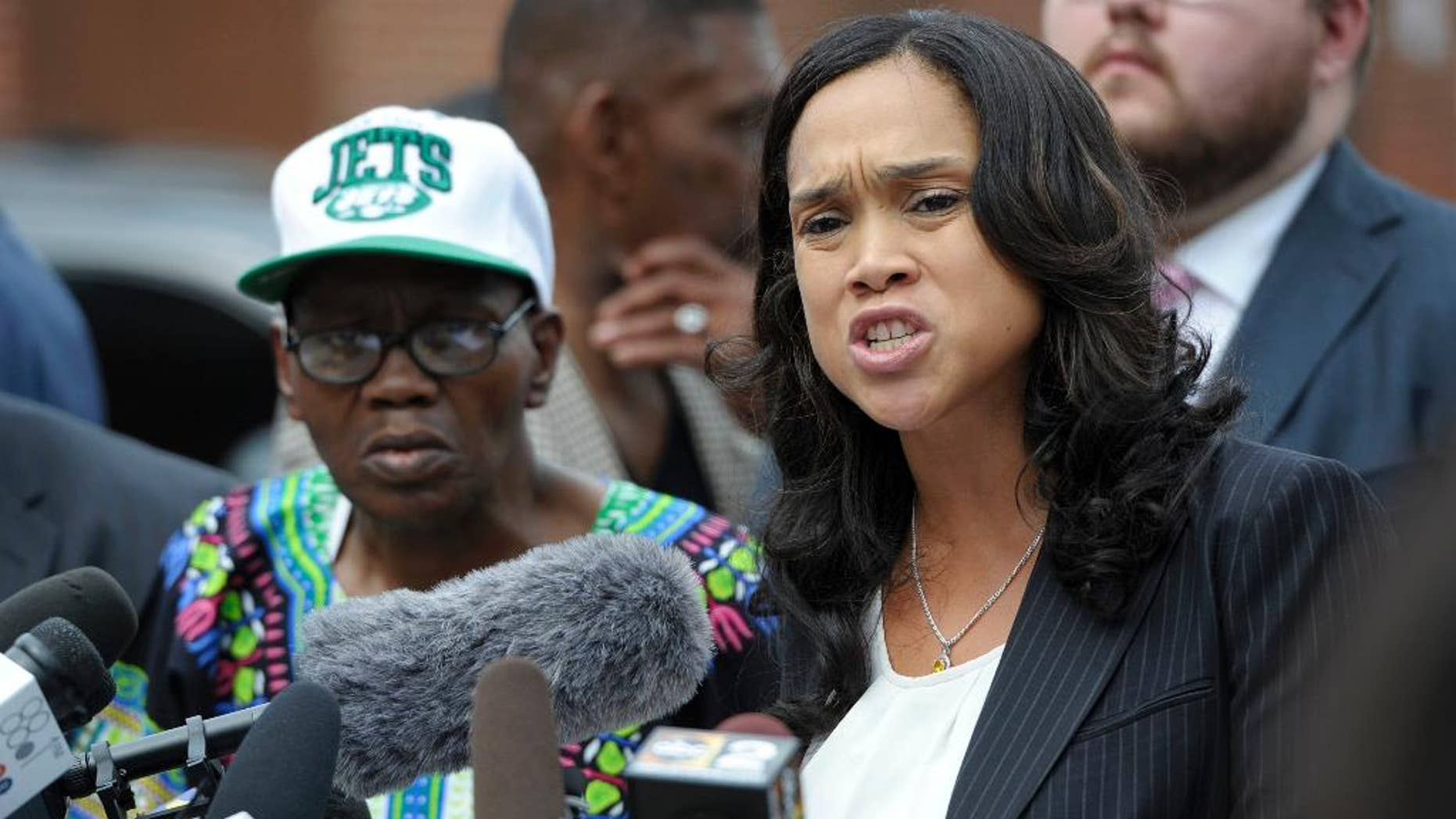 Baltimore State's Attorney Marilyn Mosby, right, holds a news conference near the site where Freddie Gray was arrested after her office dropped the remaining charges against three Baltimore police officers awaiting trial in Gray's death, in Baltimore, Wednesday, July 27, 2016.