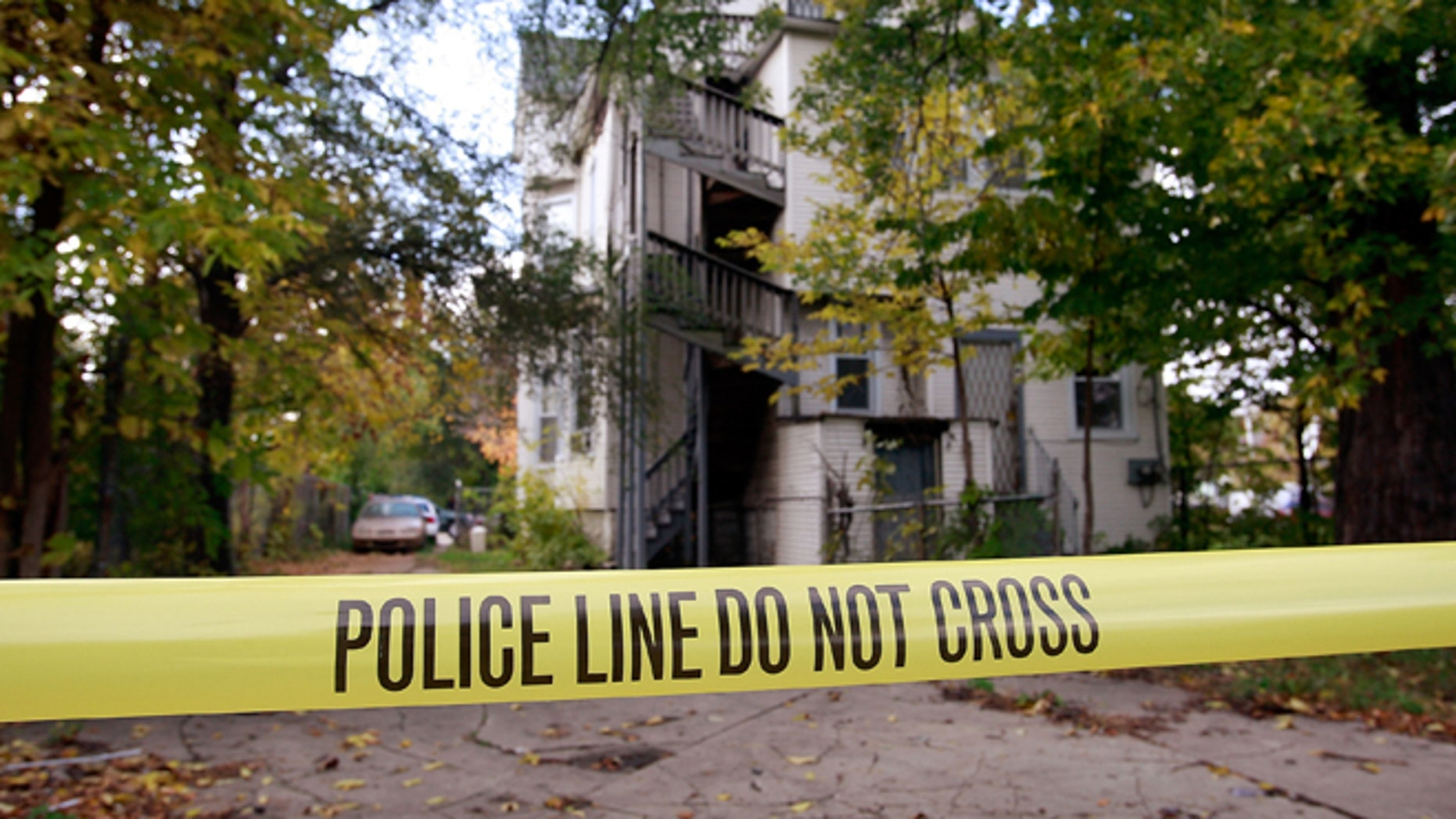 CHICAGO - OCTOBER 25:  Police Tape is streched around the outside of the home of 57-year-old Darnell Hudson Donnerson, the mother of Oscar winner Jennifer Hudson, October 25, 2008 in Chicago, Illinois. Donnerson was found shot to death in her living room yesterday and her son Jason was found shot to death in a bedroom of the home. Police are searching for Donnerson's seven-year-old grandchild who is missing from the home.  (Photo by Scott Olson/Getty Images)