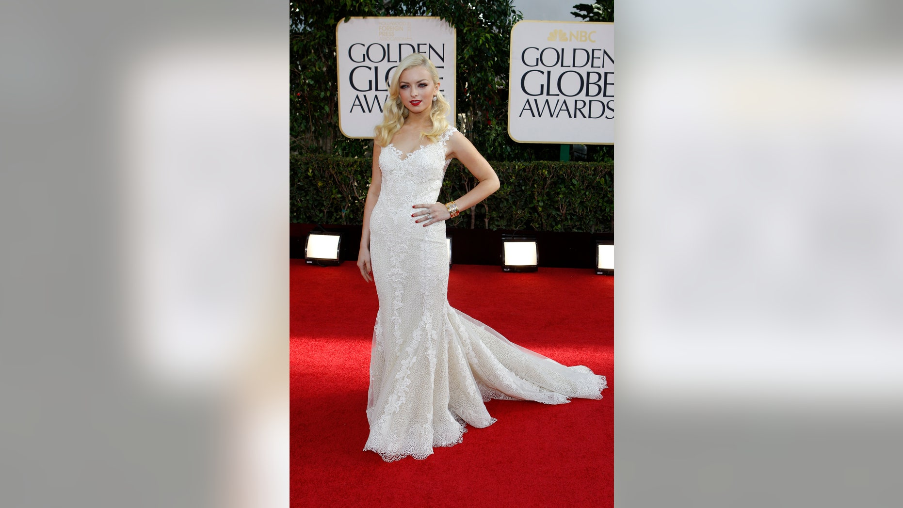 Francesca Eastwood, Miss Golden Globe 2013, poses as she arrives at the 70th annual Golden Globe Awards in Beverly Hills, California, January 13, 2013.
