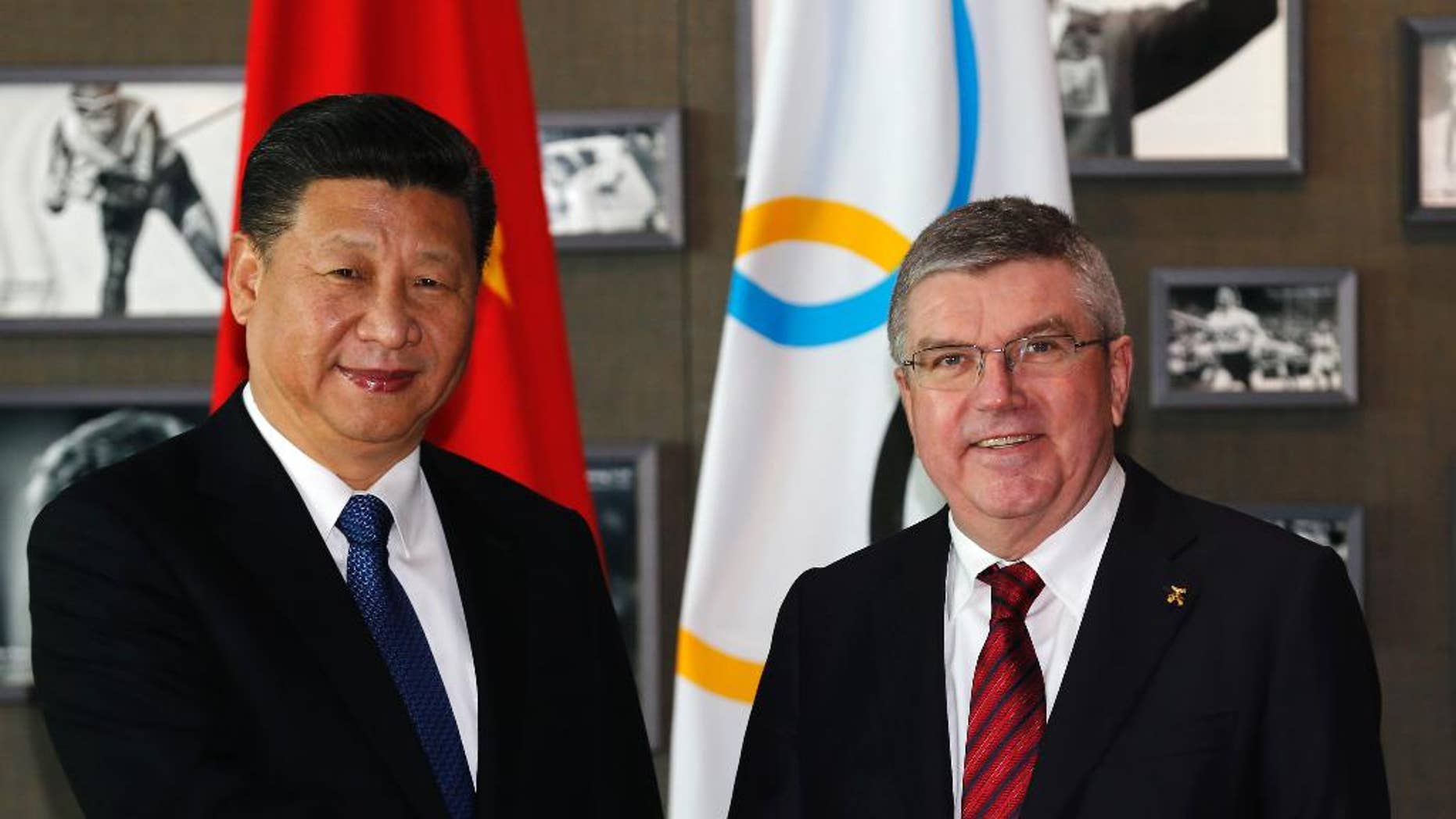 Chinese President Xi Jinping, left, shakes hand with International Olympic Committee, IOC, President Thomas Bach, right, before a meeting at the Olympic Museum in Lausanne, Switzerland, Wednesday, Jan. 18, 2017. (Denis Balibouse/Pool Photo via AP)