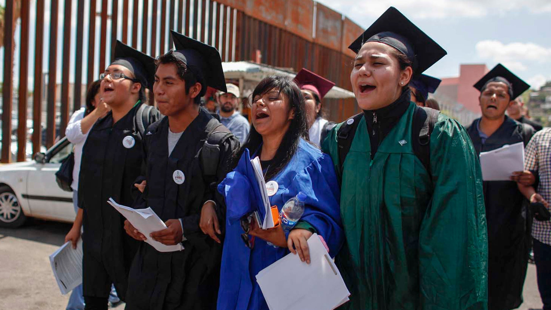 """On July 22, 2013, a group of """"Dreamers"""" marched to the U.S. port of entry in Nogales, Mexico, where they requested humanitarian parole."""
