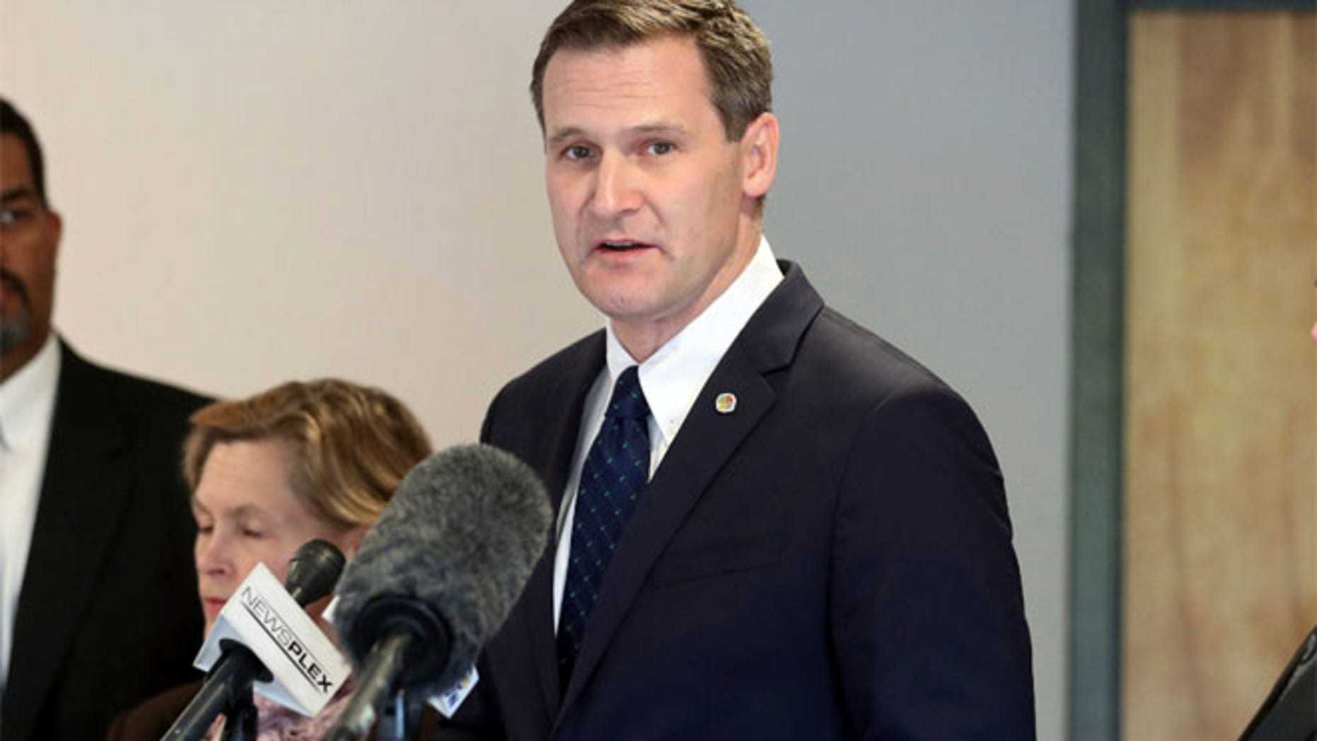FILE 2016: Charlottesville Mayor Mike Signer, center, during a press conference.