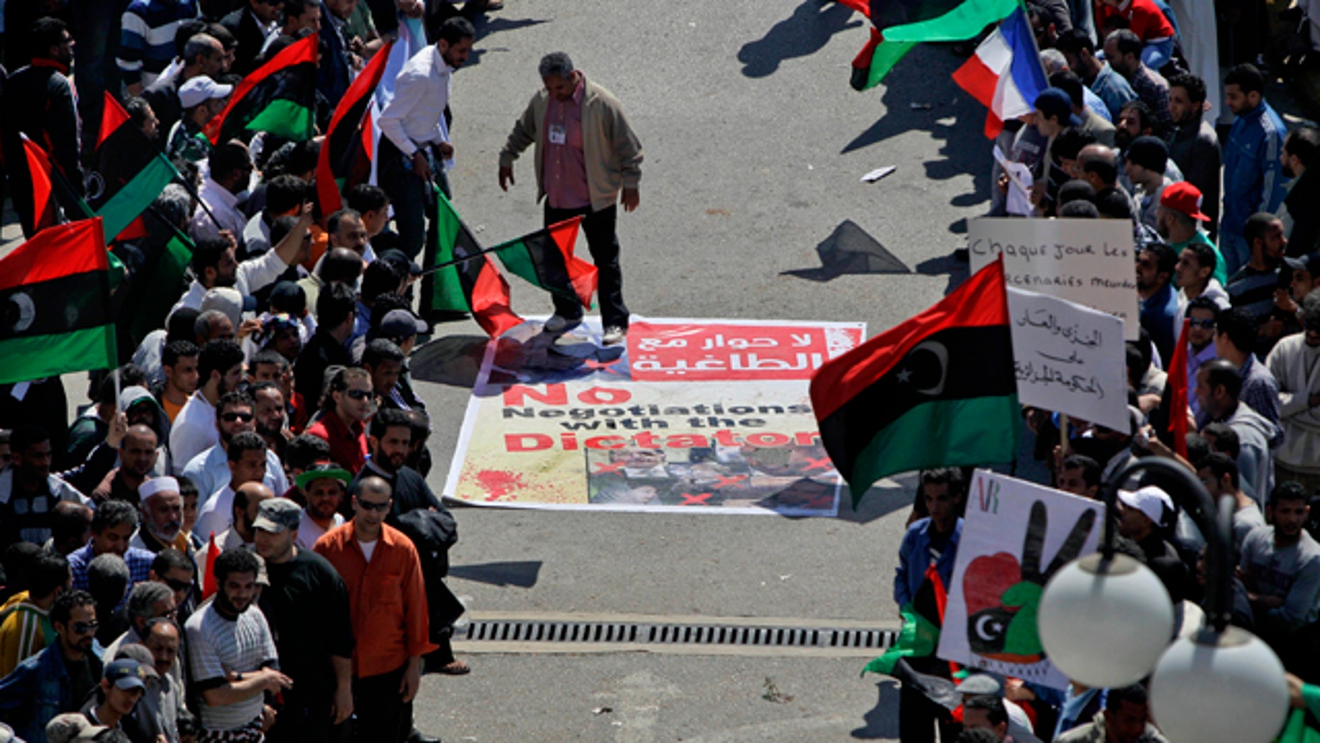 April 11: An angry but peaceful crowd lines the route to the Tibesty Hotel where an African Union delegation was meeting with opposition leaders in Benghazi, Libya. The African Union delegation took its cease-fire proposal to the rebels' eastern stronghold and was met with protests by crowds opposed to any peace until the country's longtime leader Muammar Qaddafi gives up power. (AP)