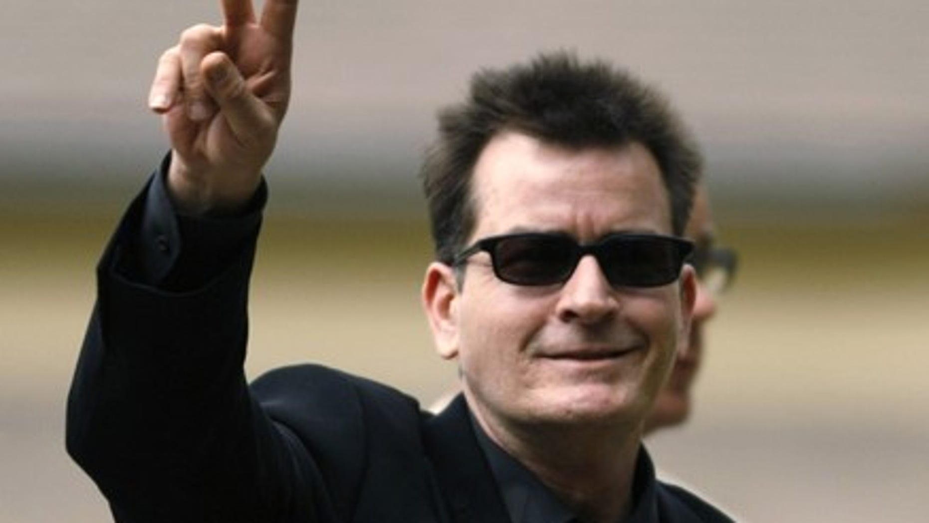 Actor Charlie Sheen arrives for a sentencing hearing at the Pitkin County Courthouse in Aspen, Colorado, on August 2, 2010. Sheen was expected to be sentenced for assaulting his wife during an alcohol-fueled Christmas Day quarrel in Aspen. (Reuters)