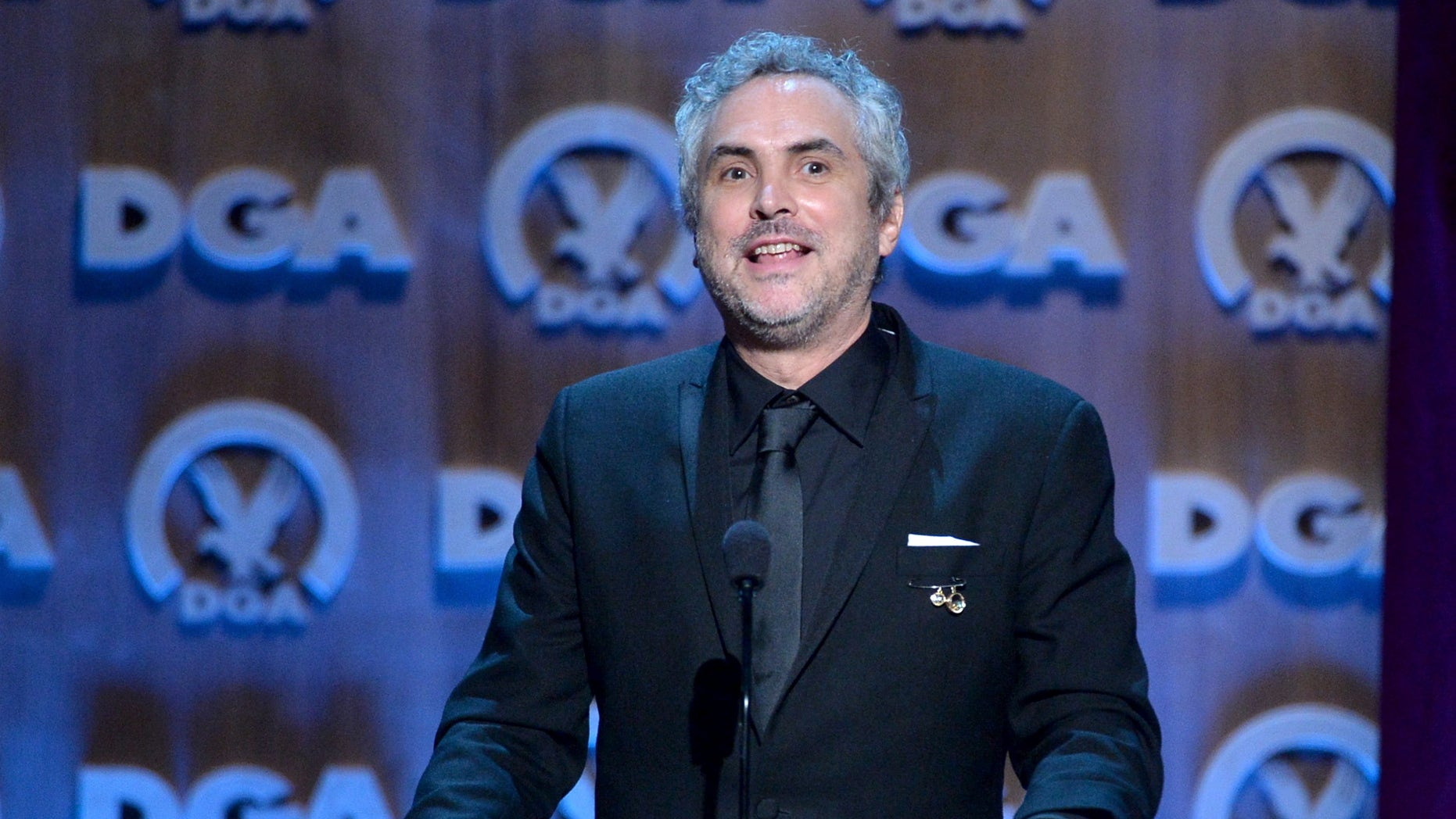 CENTURY CITY, CA - JANUARY 25:  Director Alfonso Cuaron accepts the Outstanding Directorial Achievement in Feature Film for 2013 award for ÂGravityonstage at the 66th Annual Directors Guild Of America Awards held at the Hyatt Regency Century Plaza on January 25, 2014 in Century City, California.  (Photo by Alberto E. Rodriguez/Getty Images for DGA)