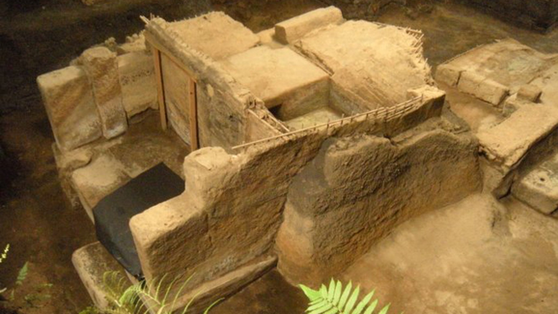 An excavated household (left), storehouse (center) and community sauna (upper right) buried by volcanic ash at Cerén around A.D. 660.