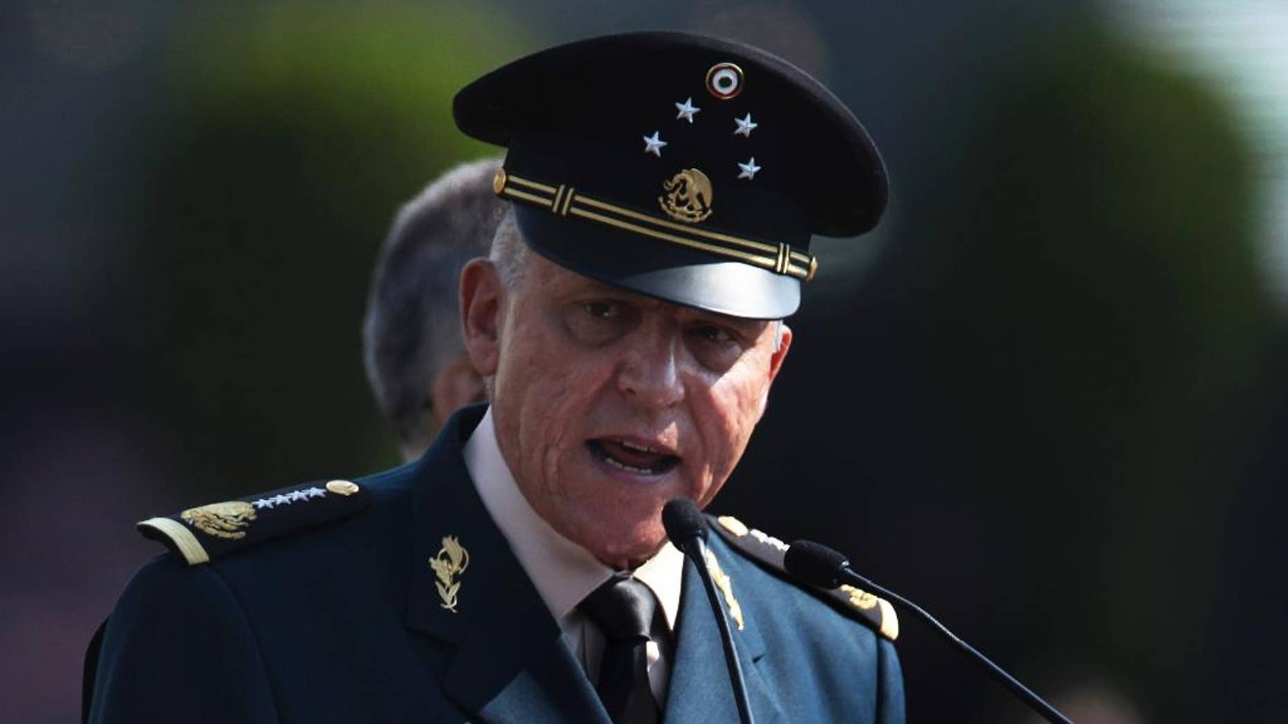 FILE - In this April 16, 2016, file photo, Mexico's Defense Secretary Gen. Salvador Cienfuegos Zepeda speaks to soldiers at the Number 1 military camp in Mexico City. Cienfuegos said Thursday, Dec. 8, that the army is uncomfortable with the law-enforcement role it was given a decade ago when the government launched an offensive against drug cartels. (AP Photo/Marco Ugarte, File)