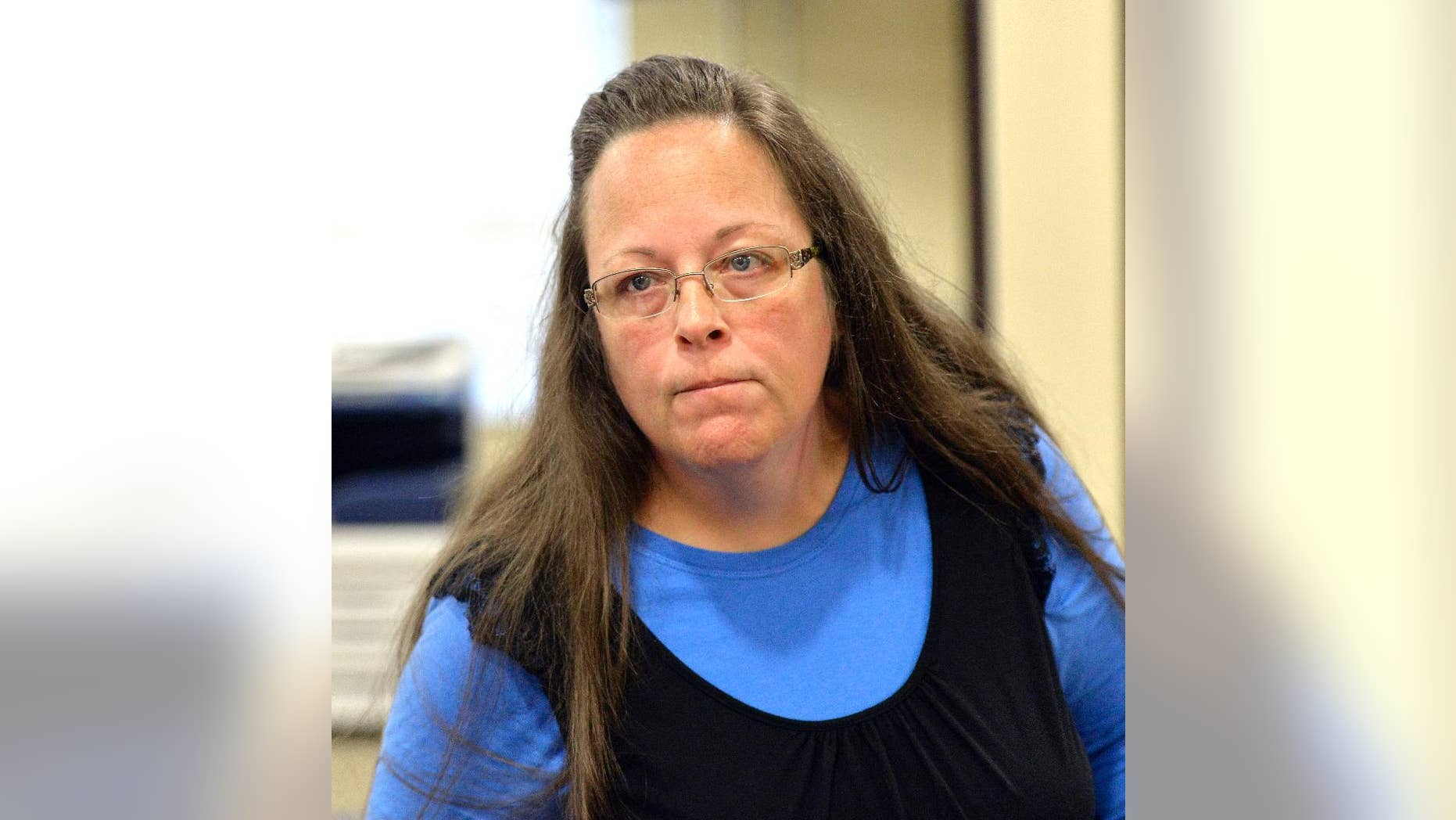 Rowan County Clerk Kim Davis listens to a customer following her office's refusal to issue marriage licenses at the Rowan County Courthouse in Morehead, Ky., Tuesday, Sept. 1, 2015. Although her appeal to the U.S. Supreme Court was denied, Davis still refuses to issue marriage licenses. (AP Photo/Timothy D. Easley)