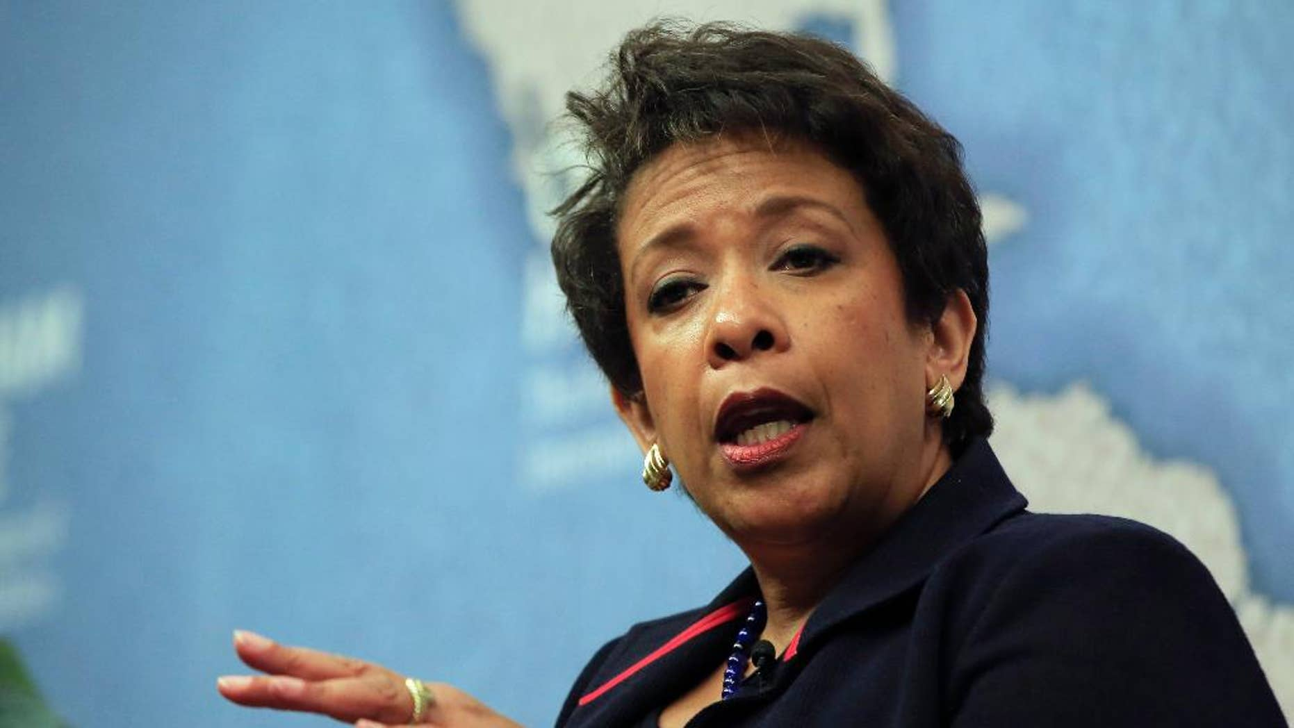 United States Attorney General Loretta Lynch gestures as she answers a question from the audience after speaking at Chatham House, The Royal Institute for International Affairs, in London, Wednesday, Dec. 9, 2015. (AP Photo/Alastair Grant)